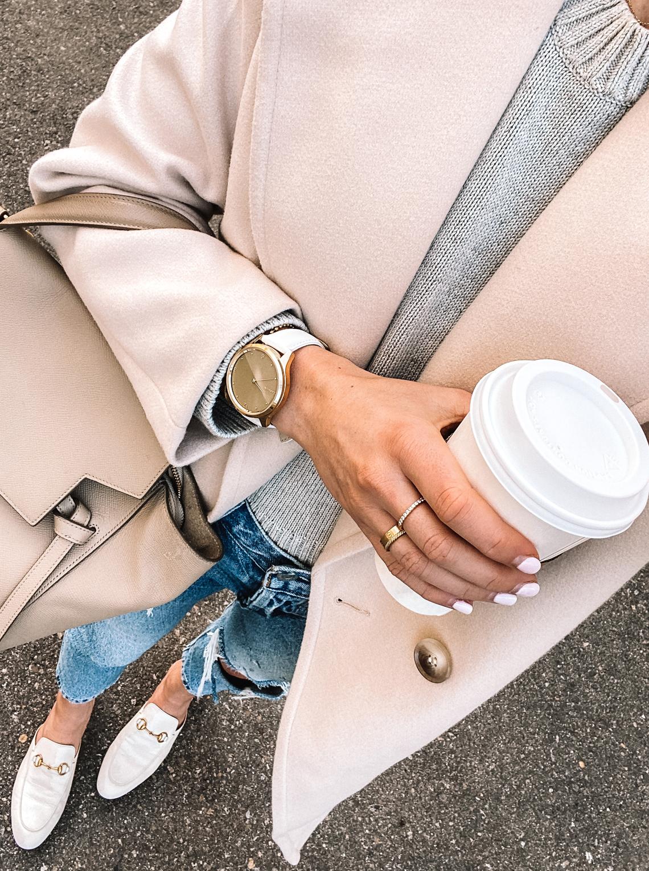 Fashion Jackson Wearing Beige Coat Grey Sweater RIpped Jeans Garmin Vivomove Luxe Watch
