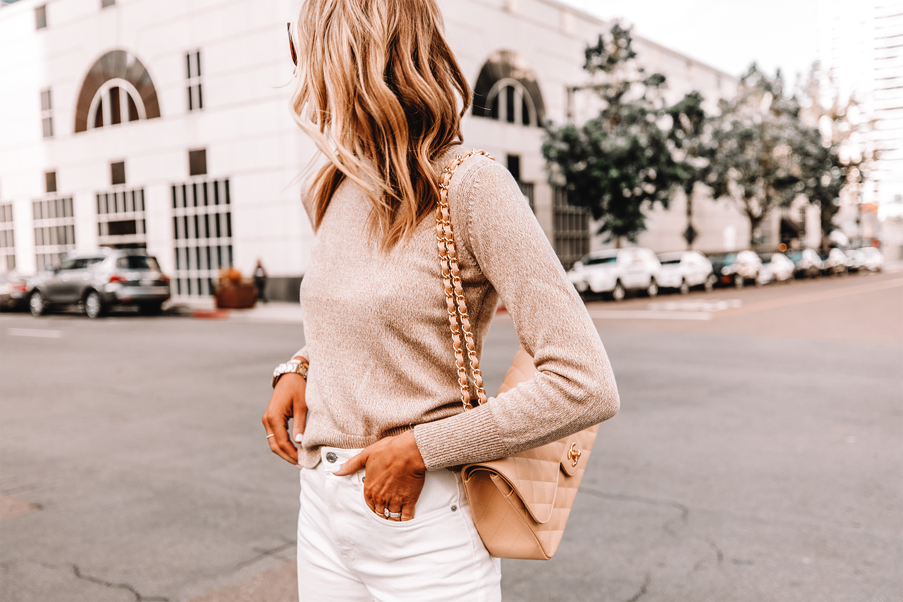 Fashion Jackson Wearing Everlane Beige Sweater White Jeans Beige Chanel Handbag
