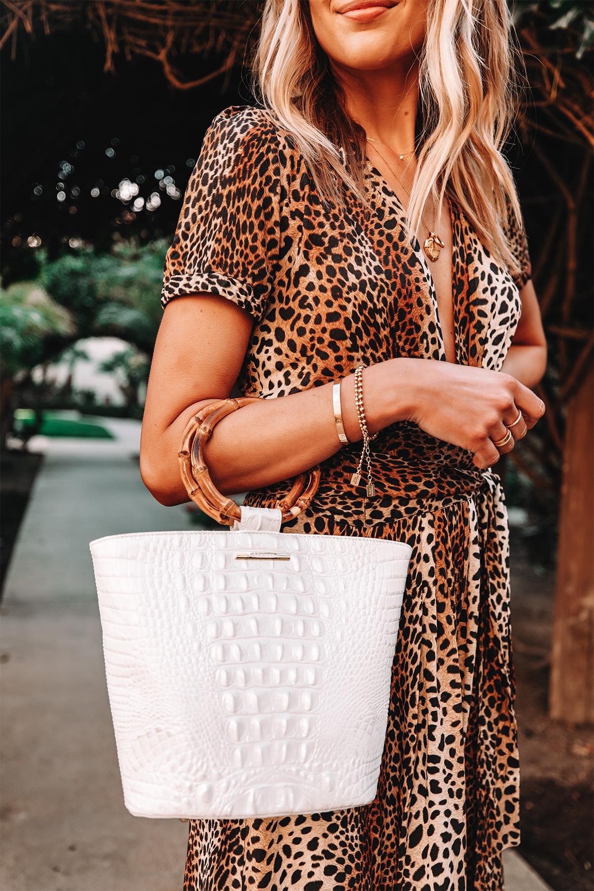 Fashion Jackson Wearing Leopard Dress Holding Brahmin Mod Bowie Handbag in White