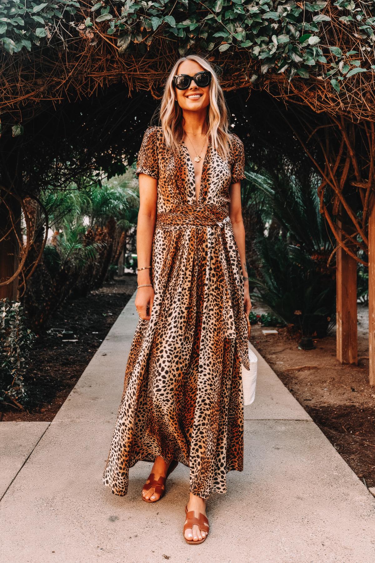 Fashion Jackson Wearing Leopard Maxi Dress Holding Hermes Oran Gold Sandals