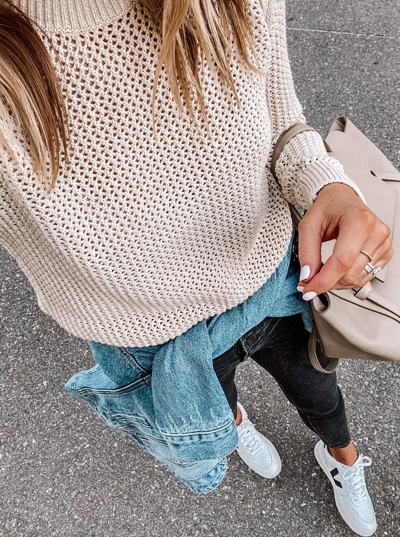 Fashion Jackson wearing Everlane Mesh Sweater Black Jeans Denim Jacket Veja Sneakers
