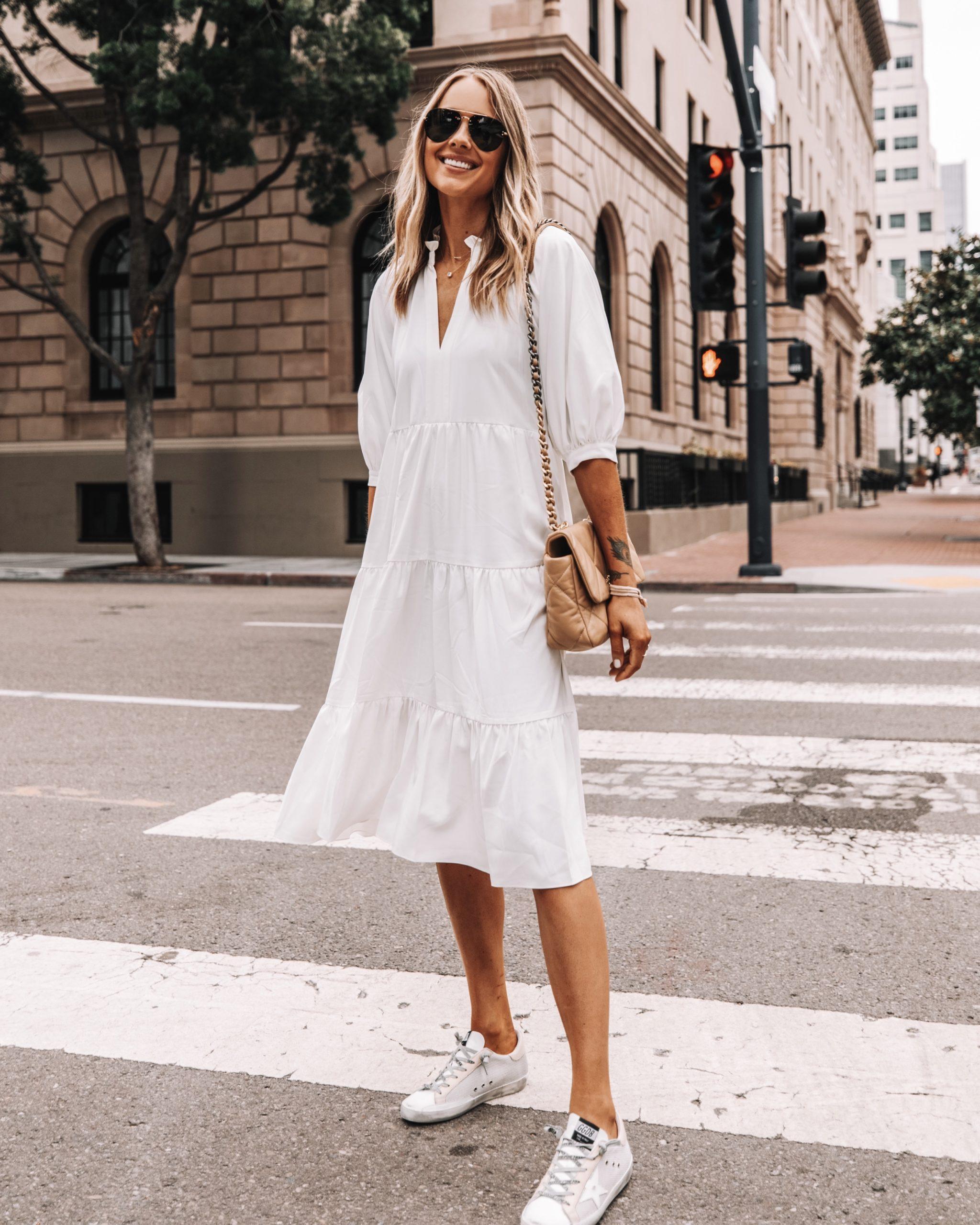 Fashion Jackson Wearing White Tiered Midi Dress Golden Goose Super Star Sneakers