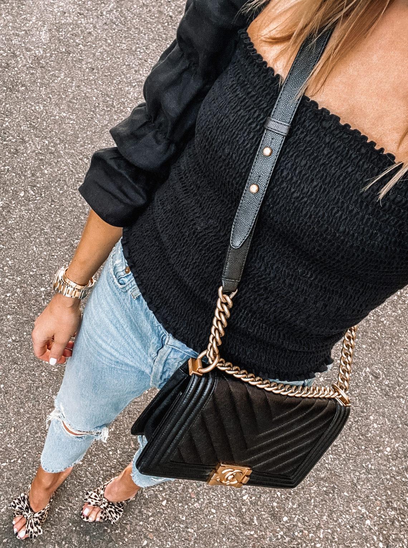 Fashion Jackson Wearing Black Smocked Top Ripped Skinny Jeans Leopard Sandals Chanel Black Boy Bag