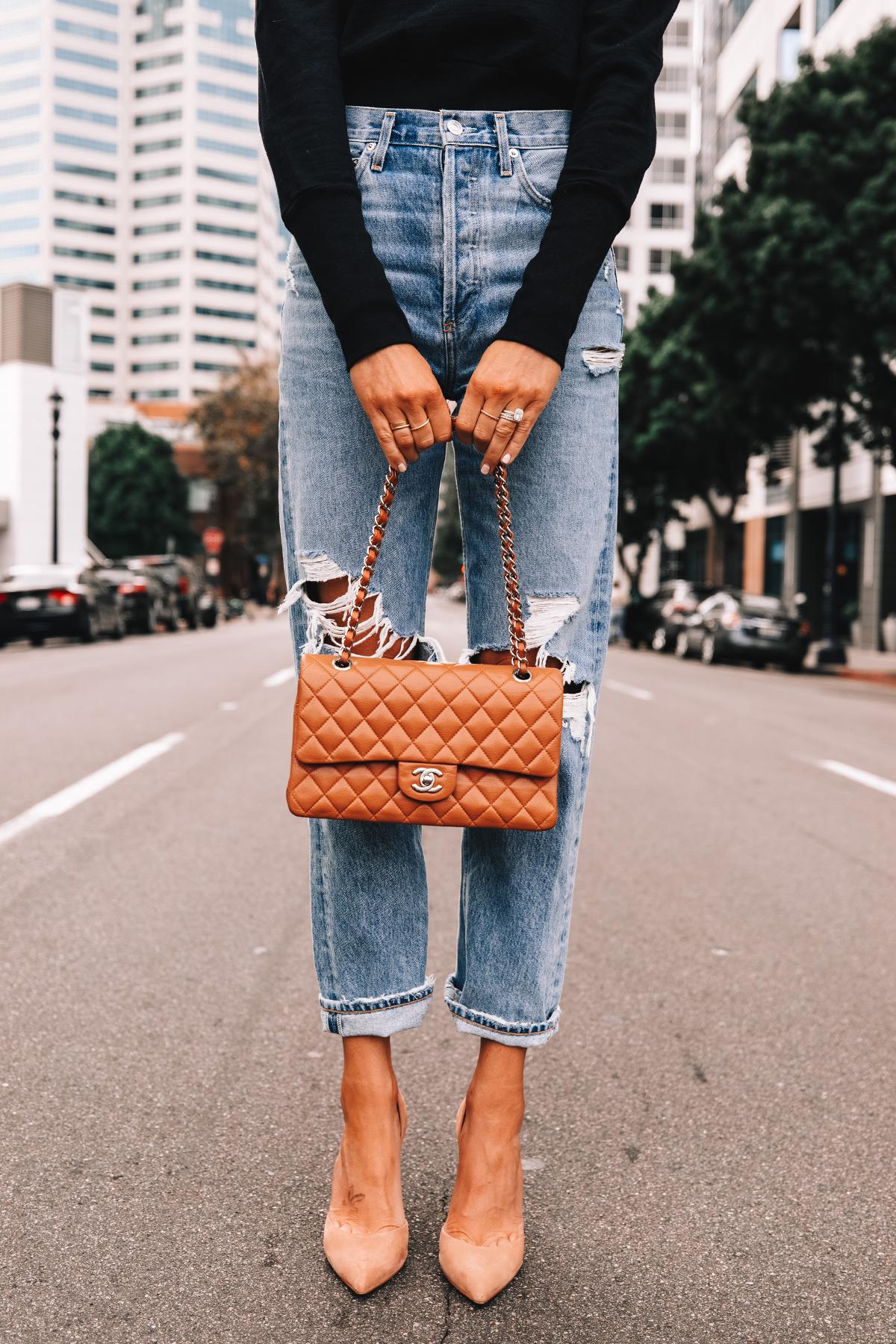 Fashion Jackson Wearing Black Sweatshirt AGOLDE Ripped Boyfriend Jeans Nude Pumps Chanel Medium Flap Camel Handbag