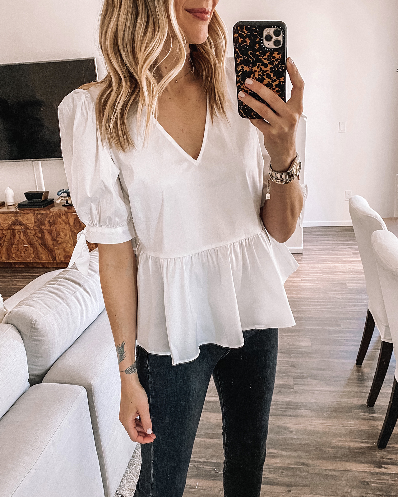 Fashion Jackson Wearing Express White Puff Sleeve Peplum Top Black Jeans
