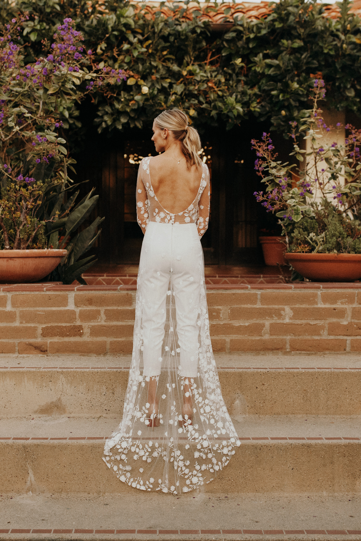 Rime Arodaky patsy white lace bridal embroidered tulle and crepe jumpsuit wedding rehearsal dinner outfit, wedding weekend bridal outfit inspiration
