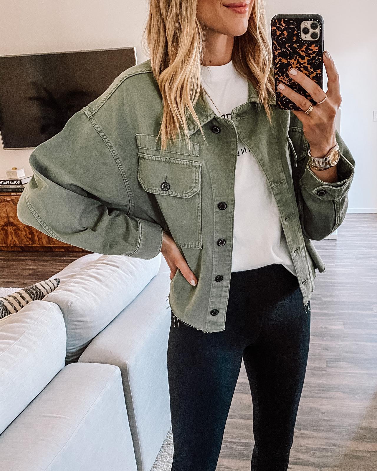 Fashion Jackson Wearing All Saints Green Utility Jacket White Anine Bing Graphic Tshirt Black Leggings 1