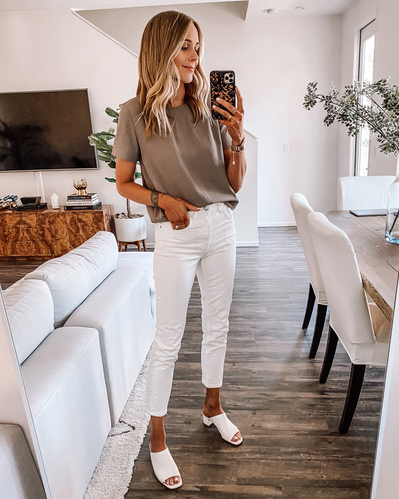 Fashion Jackson Wearing Everlane Tan Short Sleeve Blouse White Jeans White Heeled Mules