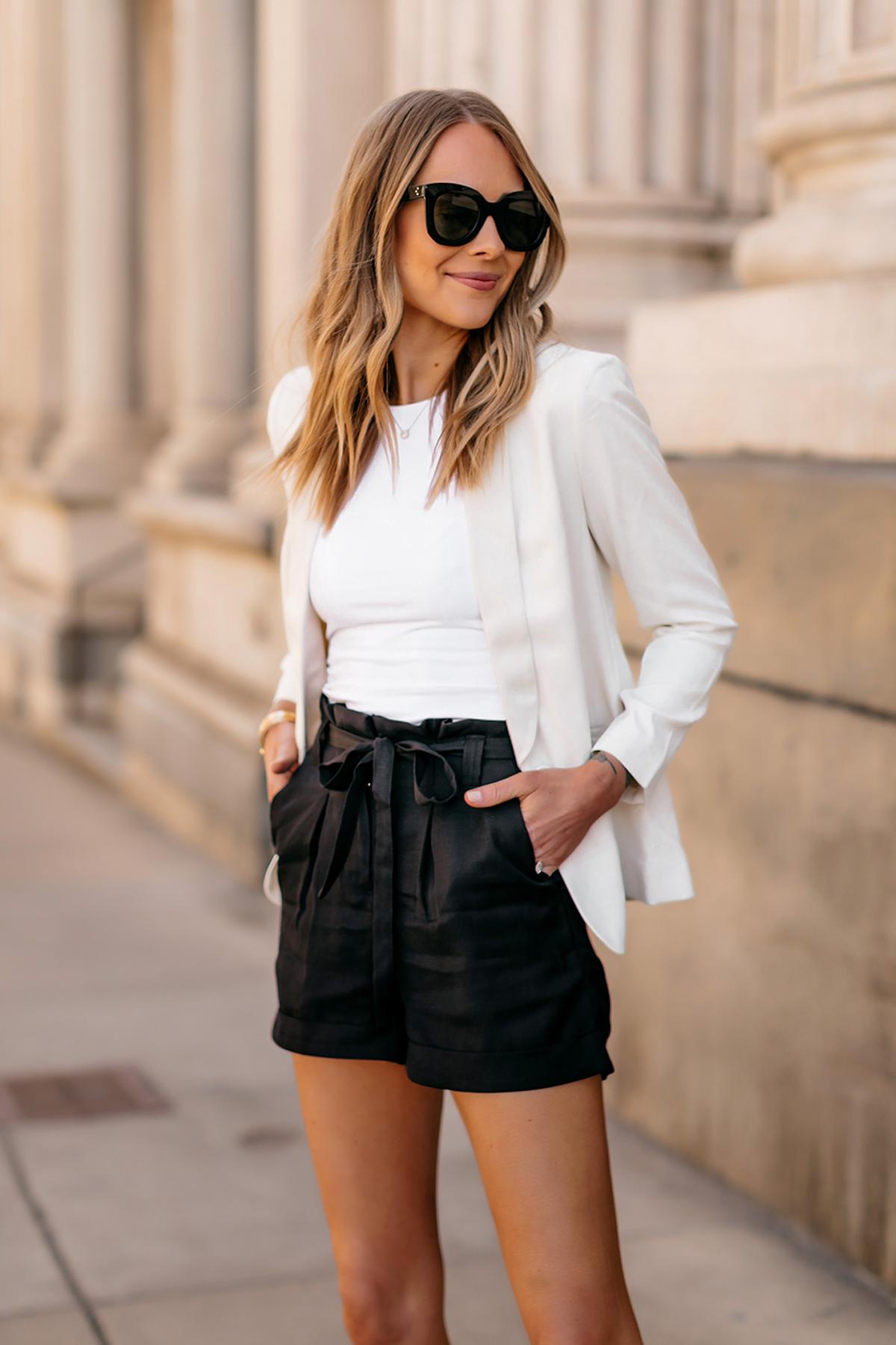 Fashion Jackson Wearing Express White Blazer White Bodysuit Black Tie Waist Shorts Modern Workwear Outfit