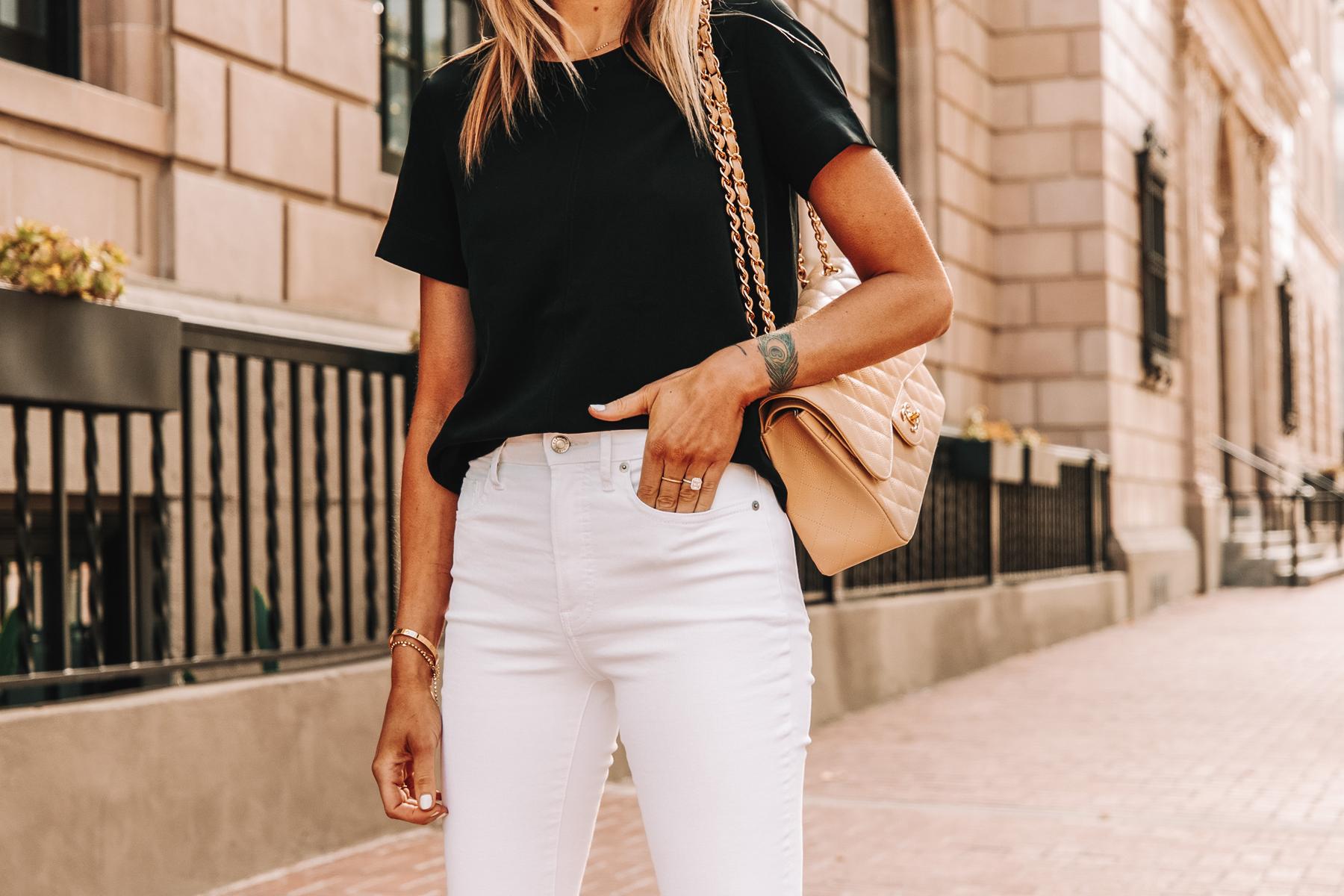 Fashion Jackson Wearing Everlane Black Short Sleeve Top White High Rise Jeans Chanel Beige Handbag 1