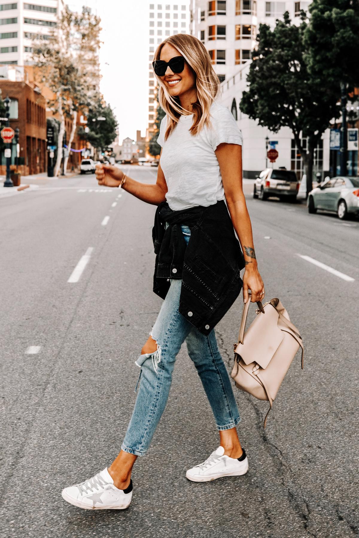Fashion Jackson Wearing ATM White T-shirt Levis Ripped Jeans Black Jean Jacket Golden Goose Sneakers Celine Mini Belt Bag 1