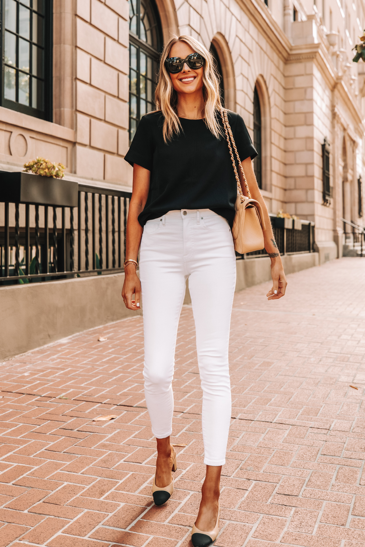 Fashion Jackson Wearing Everlane Black Short Sleeve Top Everlane White High Rise Skinny Jeans Chanel Slingbacks 1