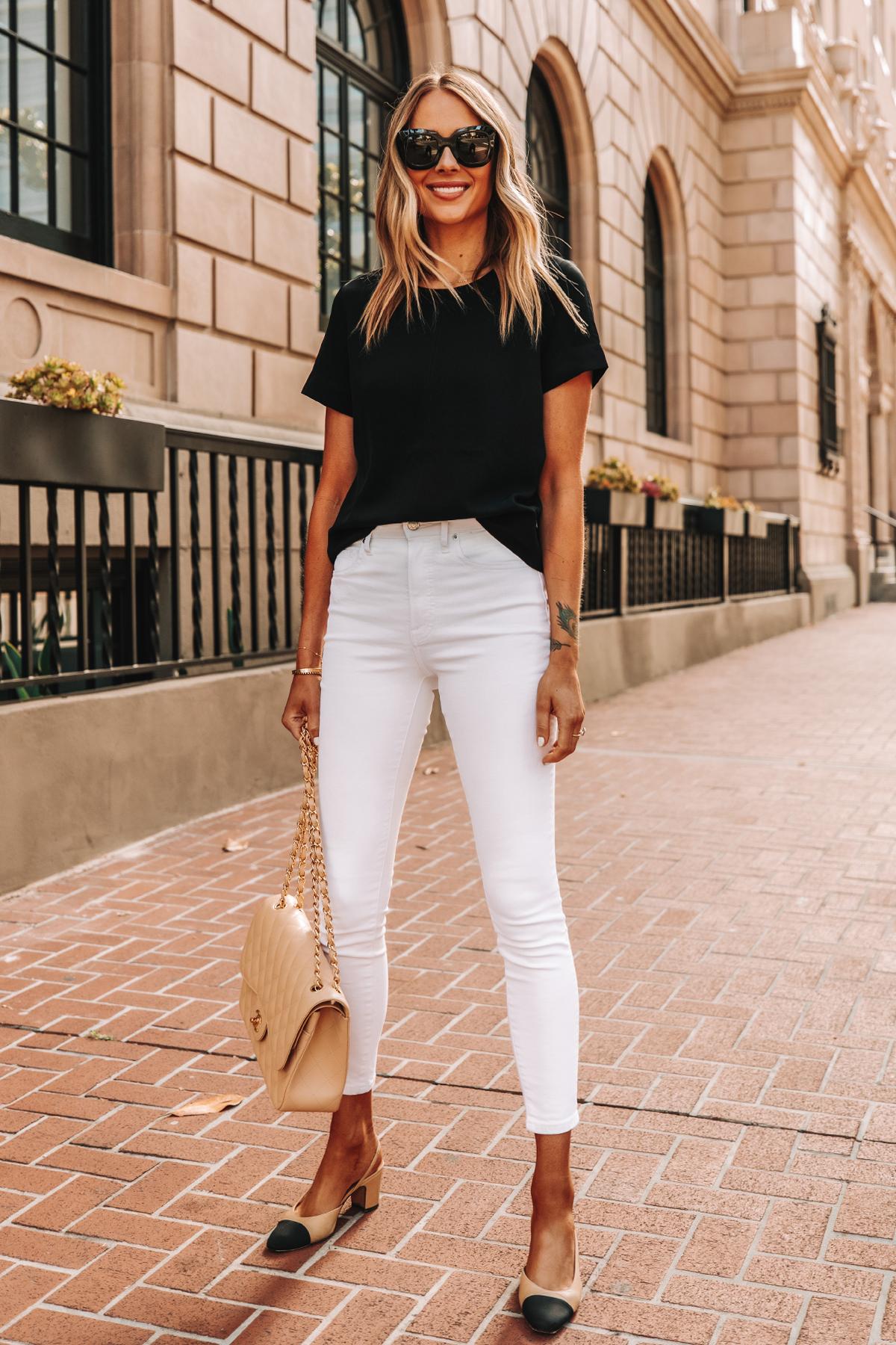 Fashion Jackson Wearing Everlane Black Short Sleeve Top Everlane White High Rise Skinny Jeans Chanel Slingbacks Chanel Beige Handbag