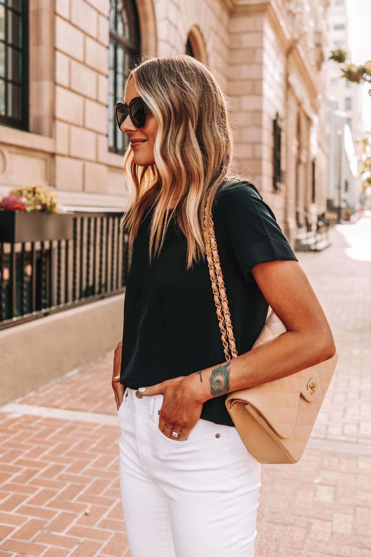 Fashion Jackson Wearing Everlane Black Short Sleeve Top High Rise White Skinny Jeans Chanel Beige Handbag