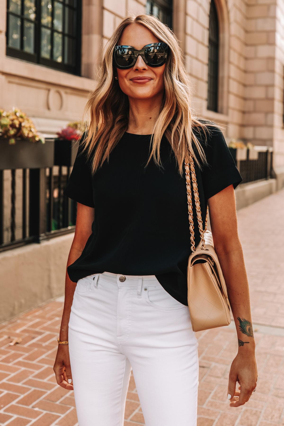 Fashion Jackson Wearing Everlane Black Short Sleeve Top White High Rise Skinny Jeans