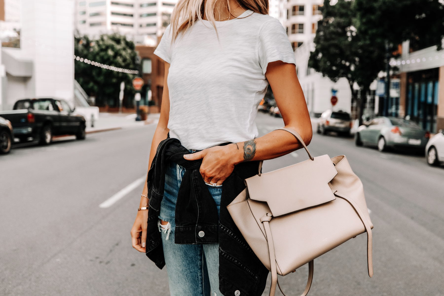 Fashion Jackson Wearing White ATM T-Shirt Black Jean Jacket Ripped Levis Jeans Celine Mini Belt Bag
