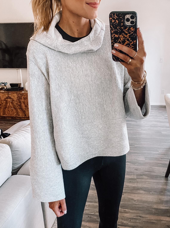 fashion jackson wearing grey lululemon sweatshirt black leggings 1