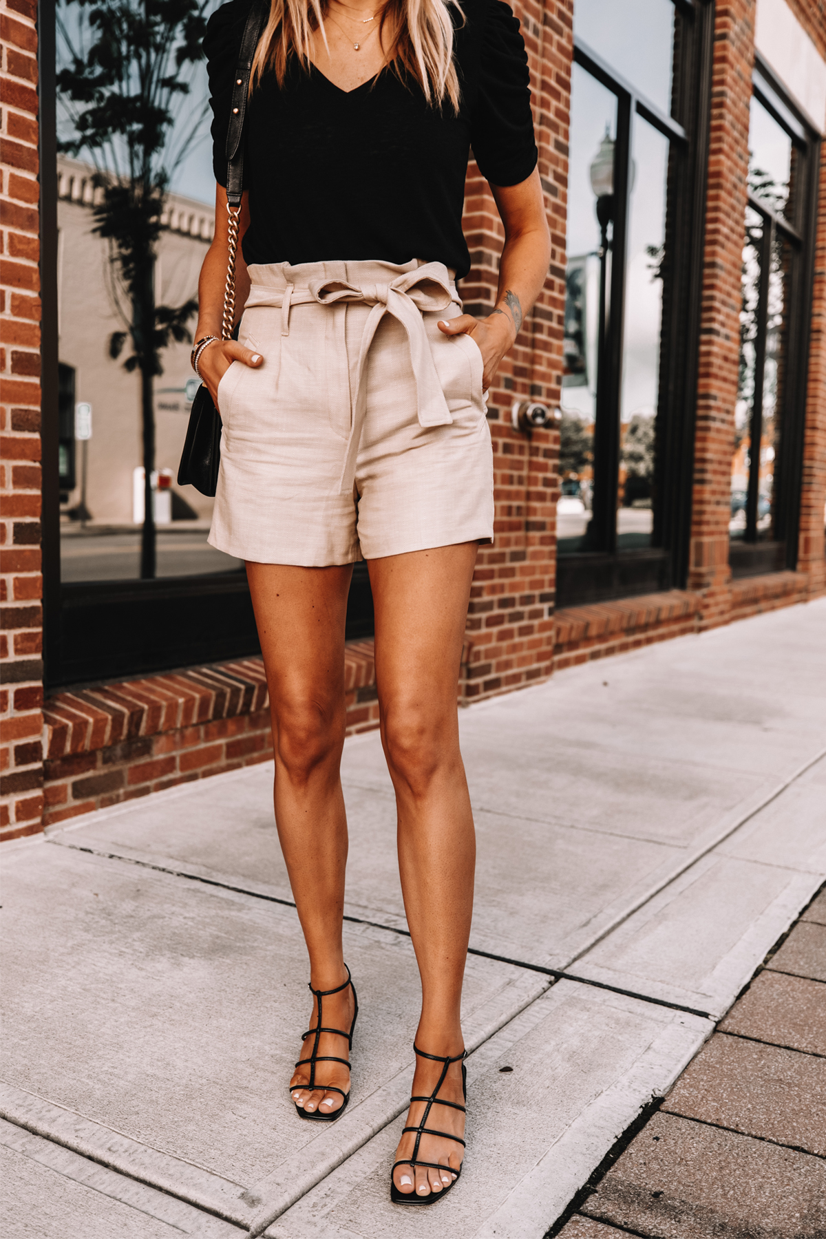 Fashion Jackson Wearing Express Black Vneck T-Shirt Tan Paperbag Waist Shorts Black Sandals Summer Outfit