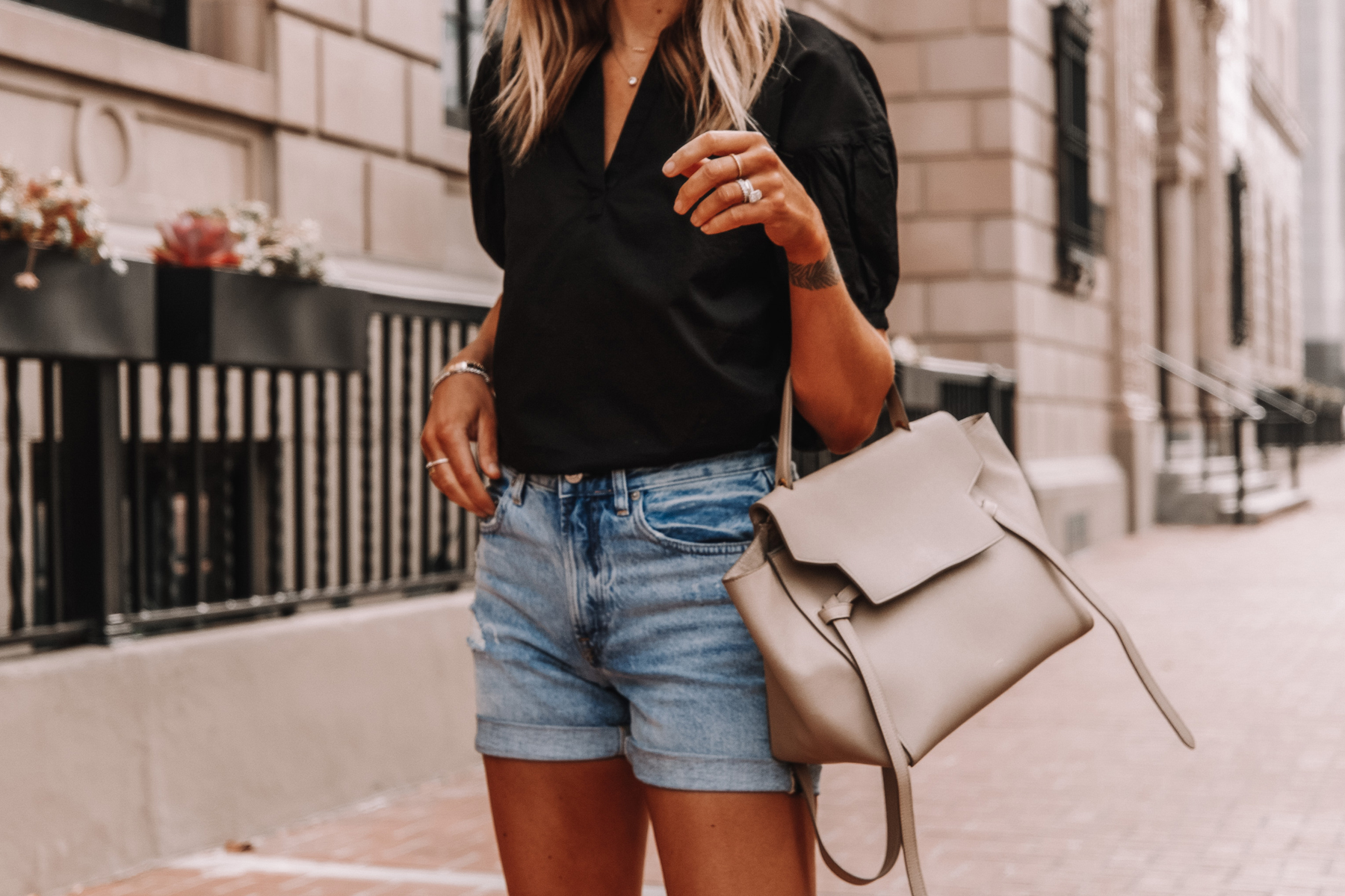 Fashion Jackson Wearing Black Everlane Split Neck Puff Sleeve Air Shirt Everlane Denim Shorts Summer Outfit 1