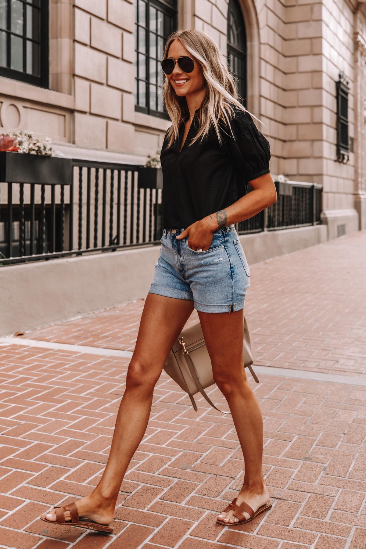 Fashion Jackson Wearing Black Everlane Split Neck Puff Sleeve Air Shirt Everlane Denim Shorts Tan Sandals Summer Outfit 1