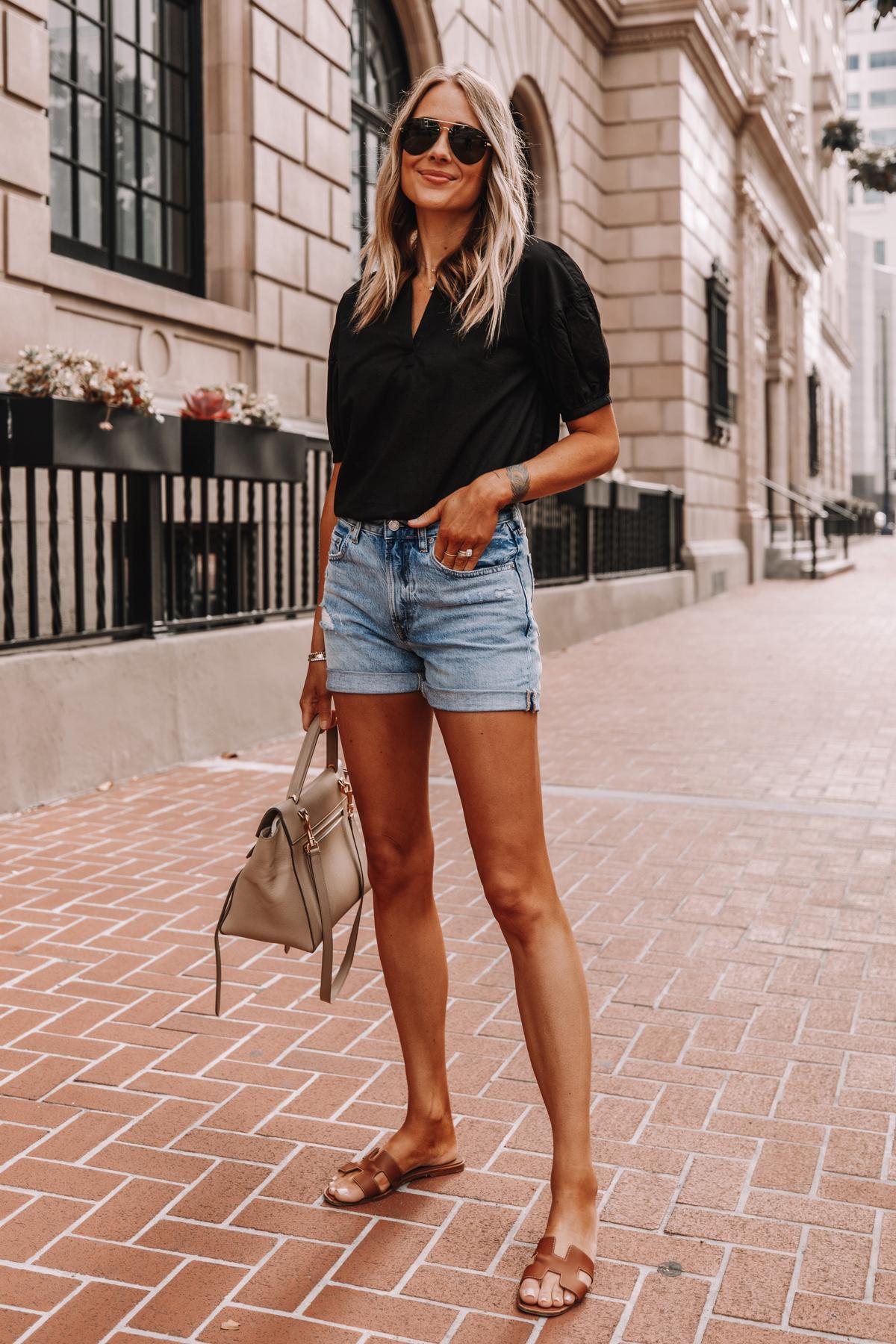 Fashion Jackson Wearing Black Everlane Split Neck Puff Sleeve Air Shirt Everlane Denim Shorts Tan Sandals Summer Outfit 3