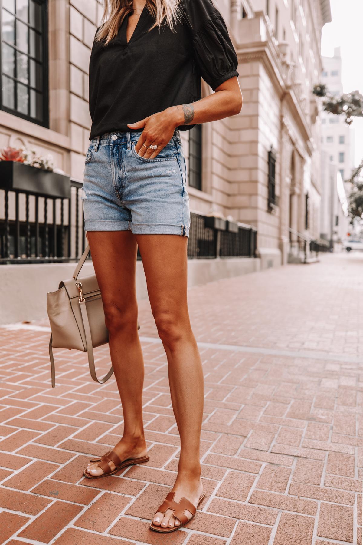 Fashion Jackson Wearing Black Everlane Split Neck Puff Sleeve Air Shirt Everlane Denim Shorts Tan Sandals Summer Outfit