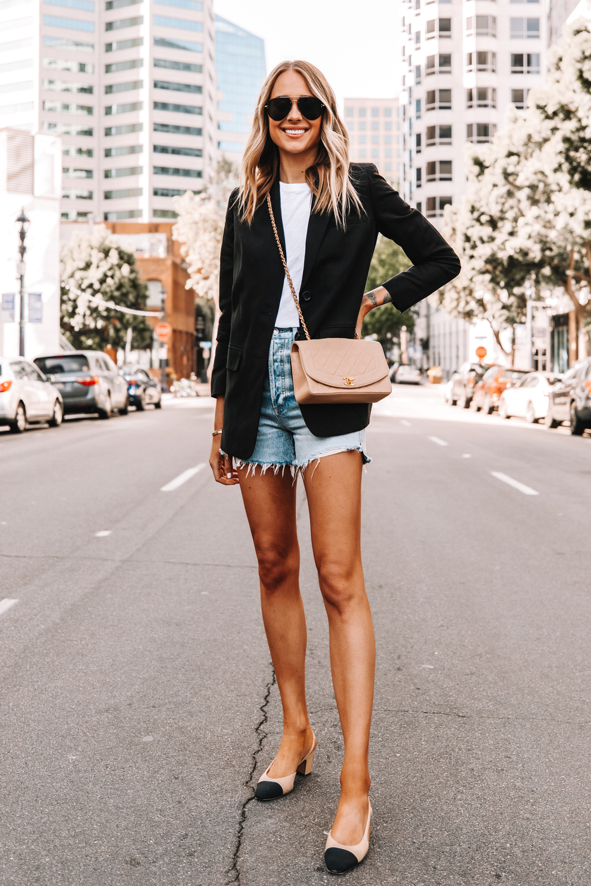 Fashion Jackson Wearing Everlane Black Blazer White Tshirt High Rise Denim Shorts Chanel Slingbacks Beige Chanel Handbag Street Style 1
