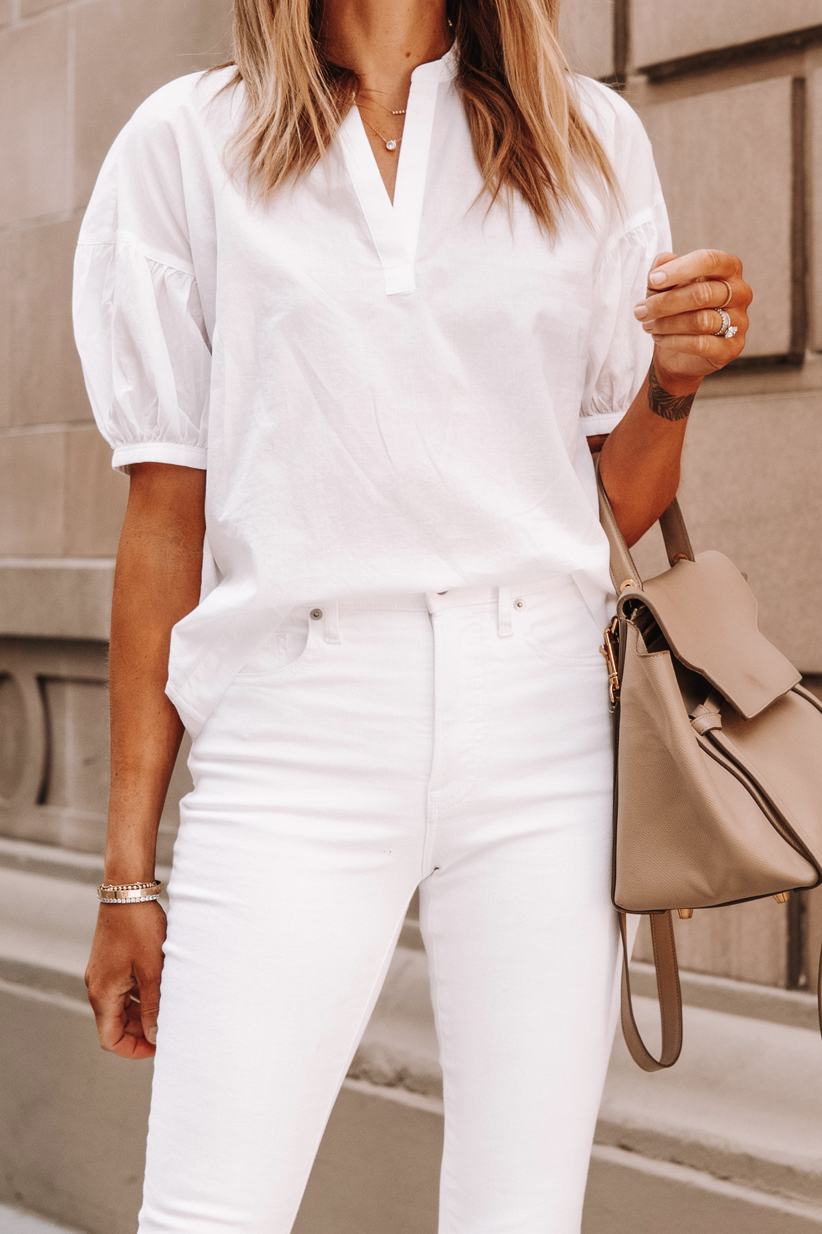 Fashion Jackson Wearing Everlane White Puff Sleeve Top White Skinny Jeans Celine Belt Bag 1