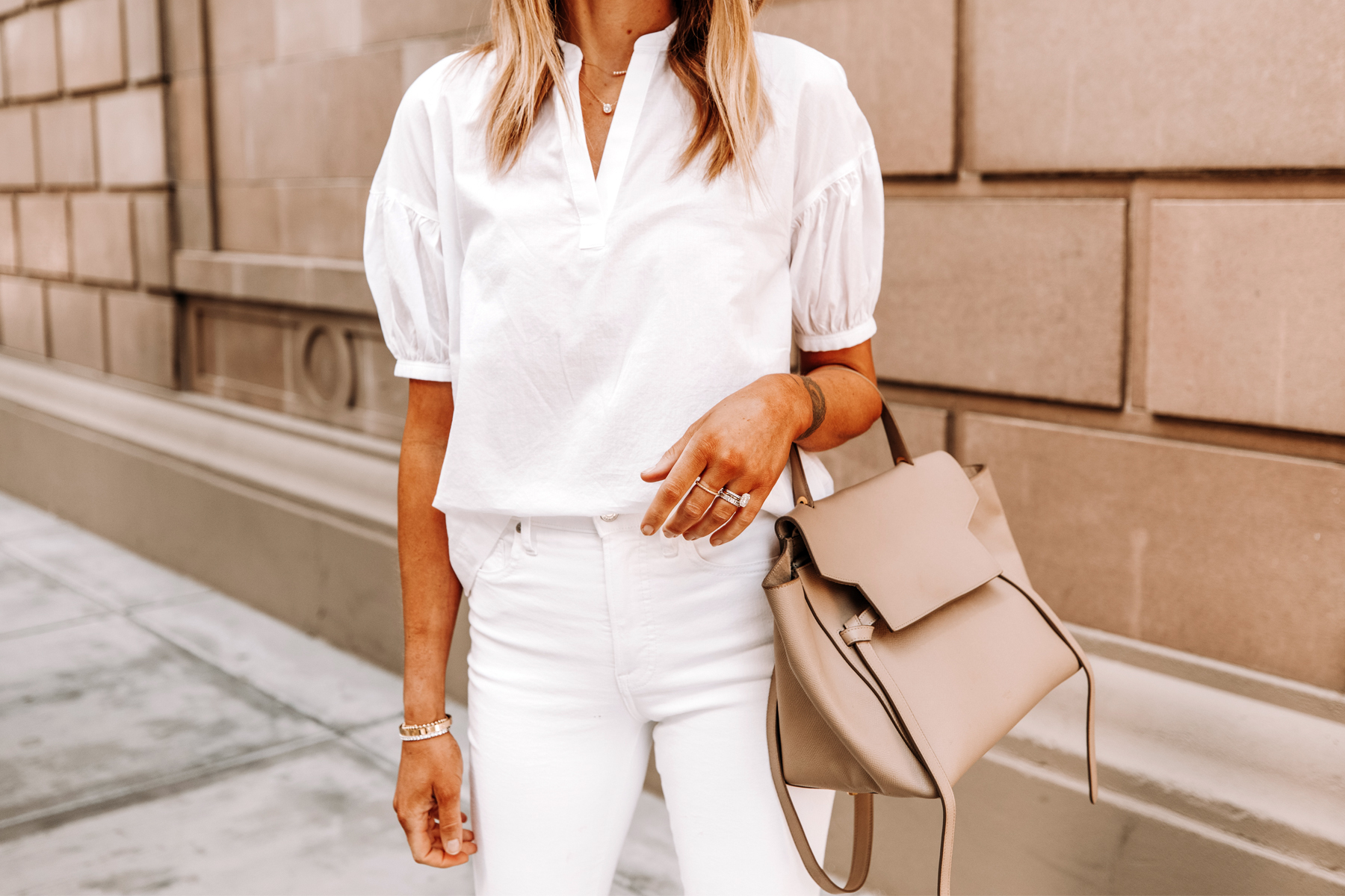 Fashion Jackson Wearing Everlane White Puff Sleeve Top White Skinny Jeans Celine Belt Bag