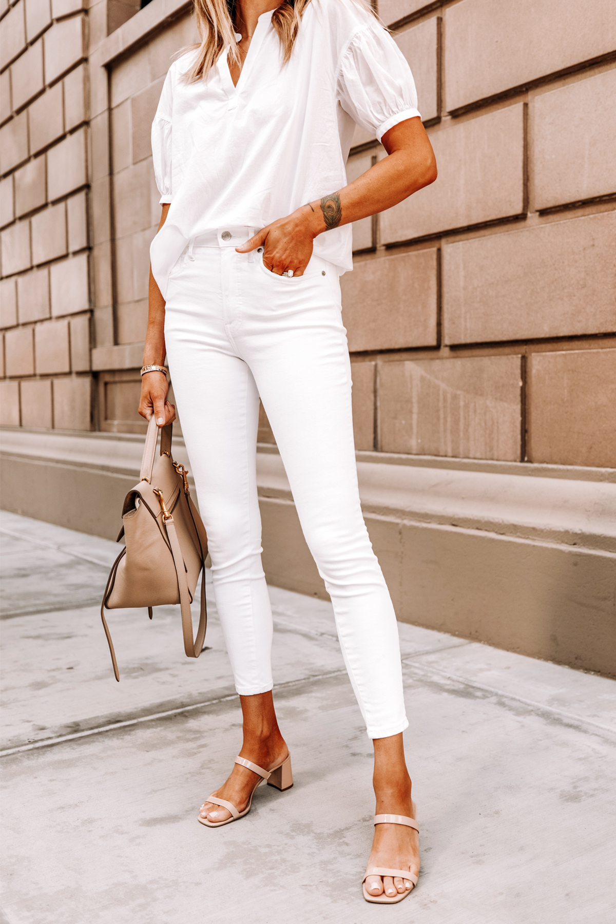 Fashion Jackson Wearing Everlane White Top Everlane White Skinny Jeans Tan Block Heel Sandals