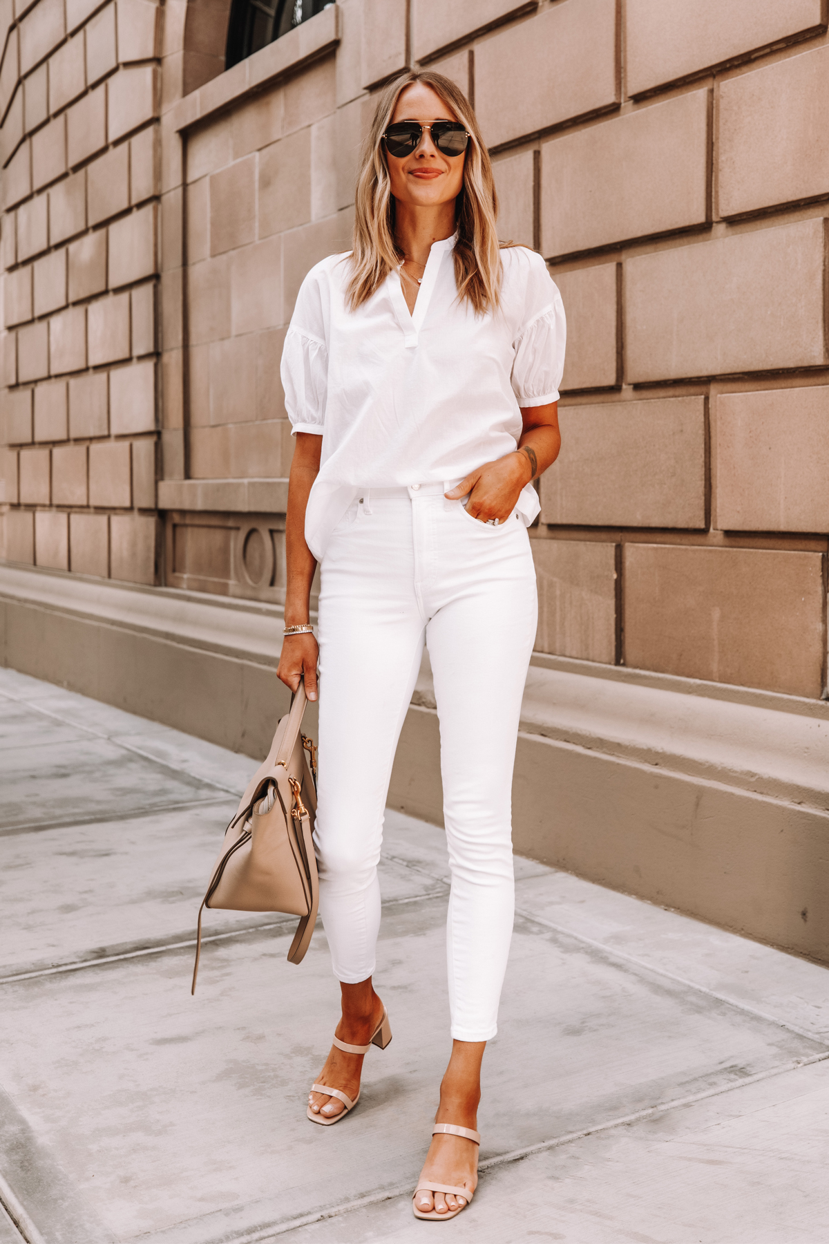 Fashion Jackson Wearing Everlane White Top Everlane White Skinny Jeans Tan Sandals Celine Belt Bag 2