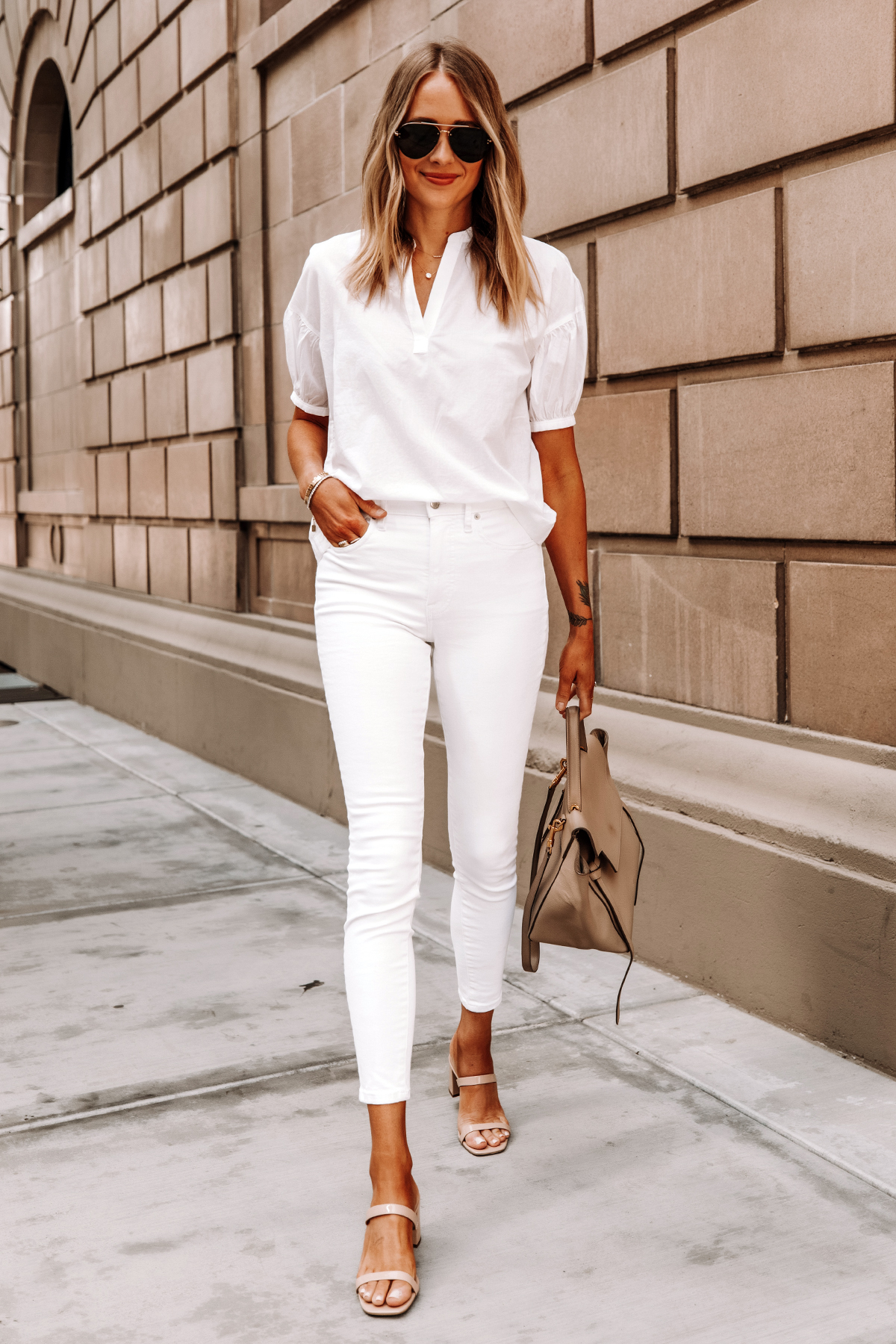 Fashion Jackson Wearing Everlane White Top Everlane White Skinny Jeans Tan Sandals Celine Belt Bag
