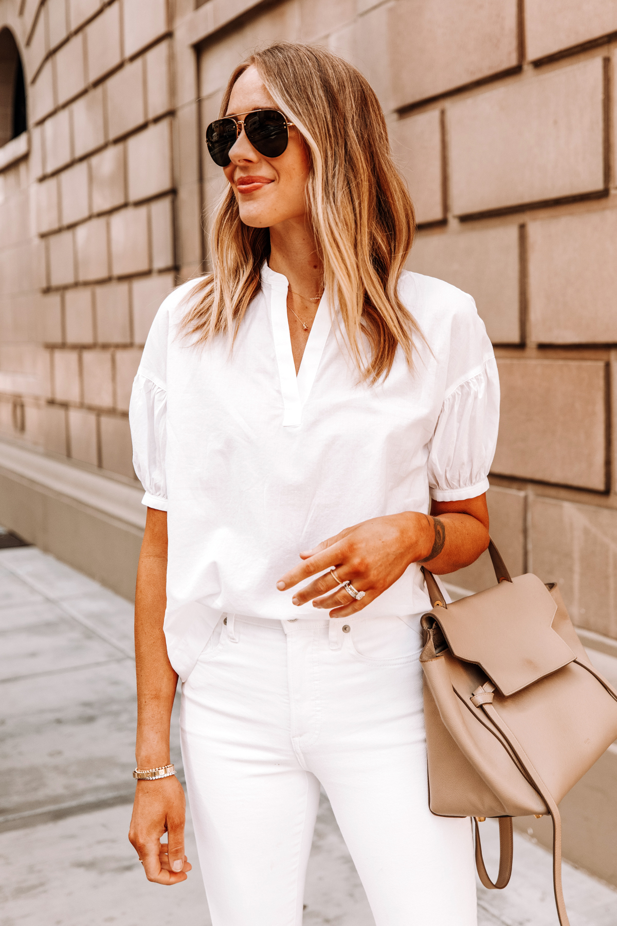 Fashion Jackson Wearing Everlane White Top White Skinny Jeans Celine Belt Bag