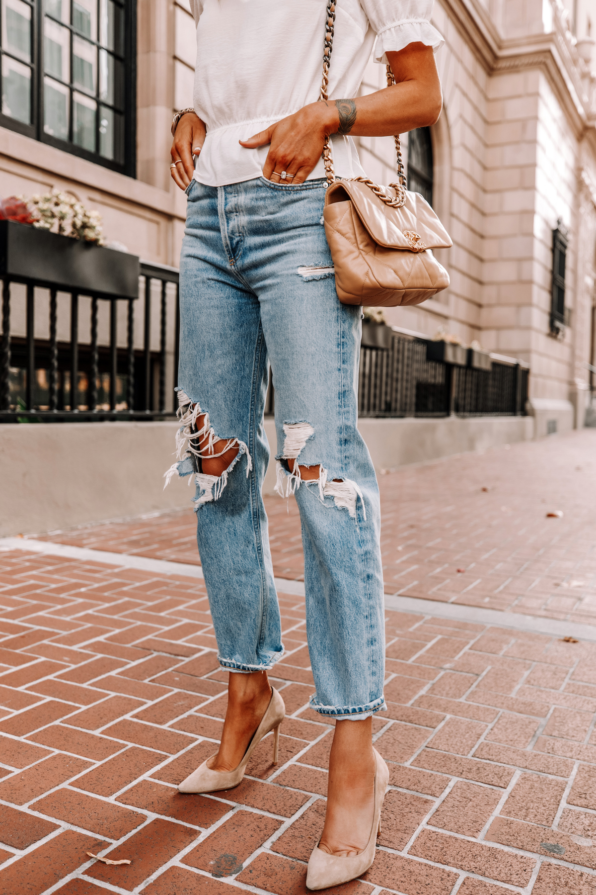 Fashion Jackson Wearing White Peplum Top AGOLDE Ripped 90s Jeans Nude Pumps Chanel 19 Beige Handbag