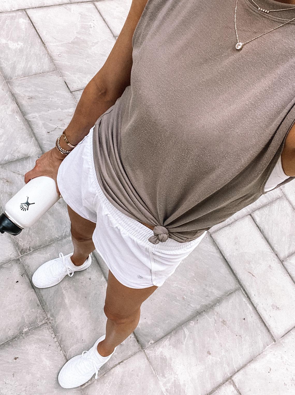 Fashion Jackson Wearing Athleta Tank White Shorts White APL Sneakers