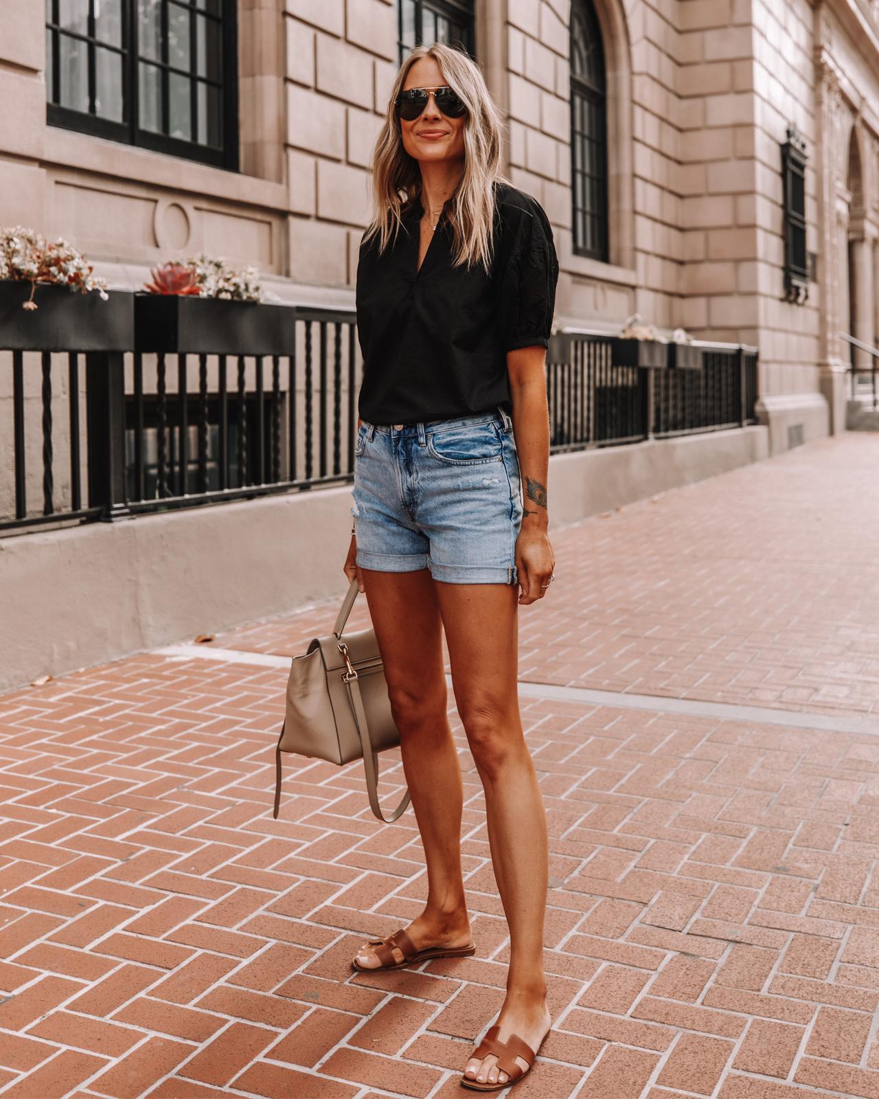 Fashion Jackson Wearing Everlane Black Puff Sleeve Top Everlane Denim Shorts Tan Sandals
