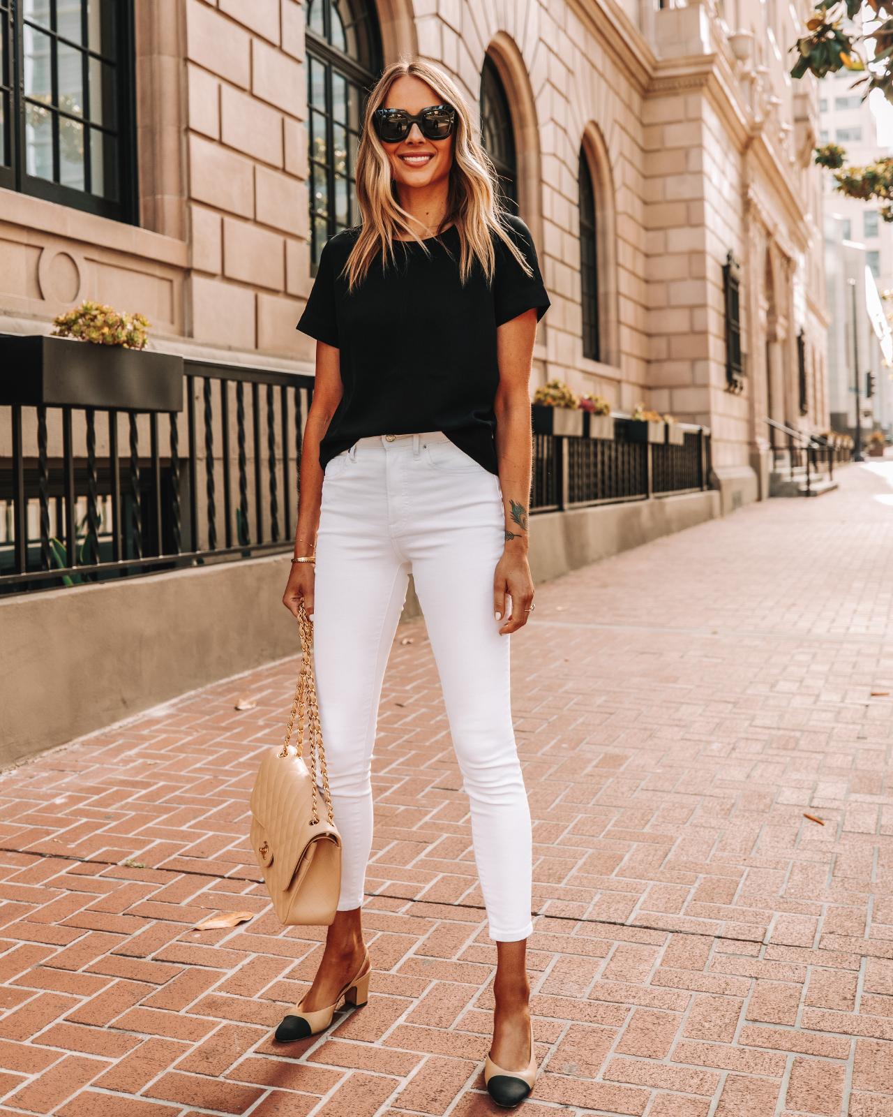 Fashion Jackson Wearing Everlane Black Top Everlane White Skinny Jeans Chanel Slingbacks