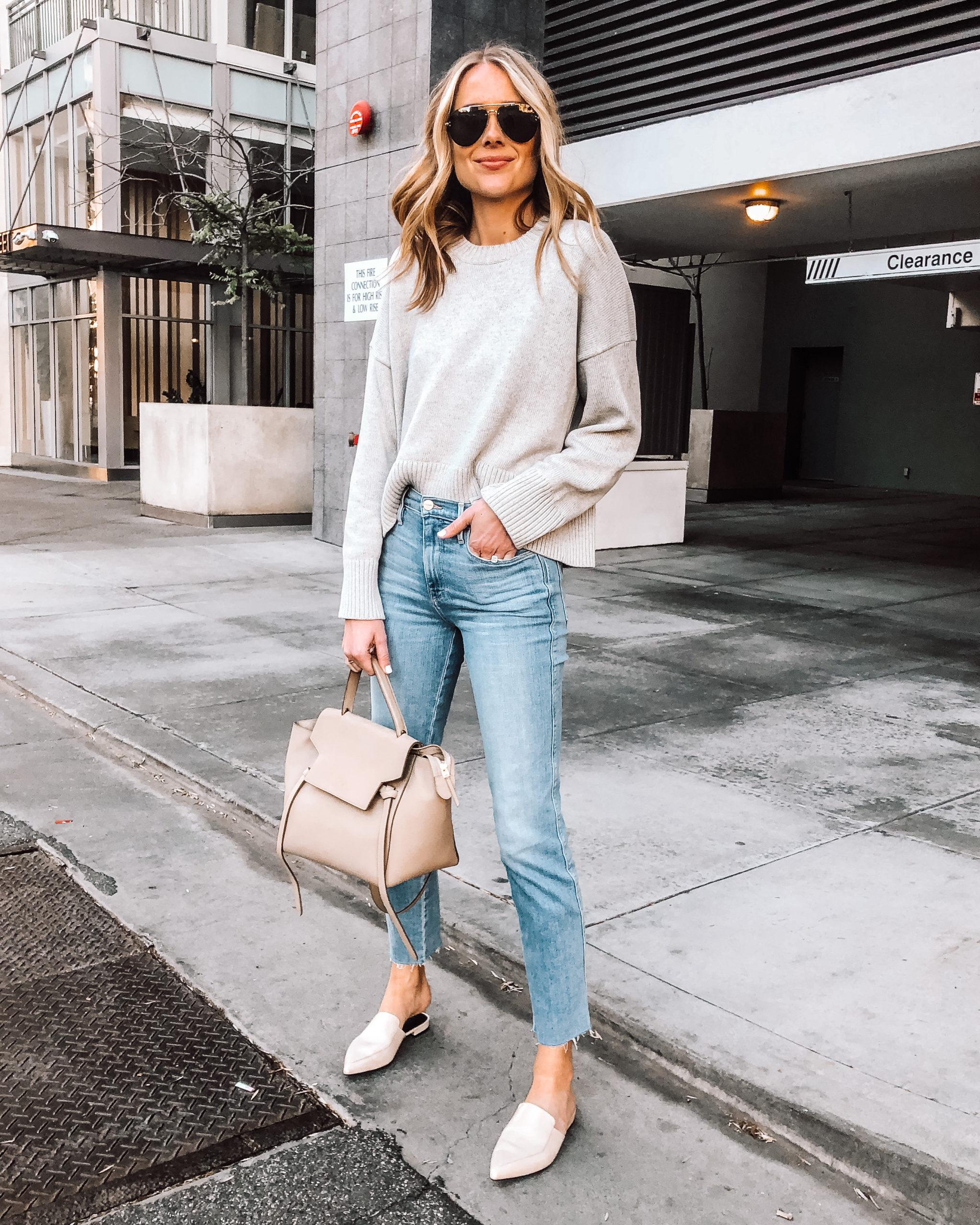 Fashion Jackson Wearing Everlane Grey Sweater Raw Hem Jeans Ivory Mules