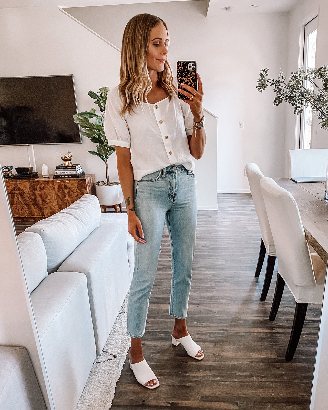 Fashion Jackson Wearing Everlane Linen White Puff Sleeve Top Light Wash Jeans White Heeled Mules