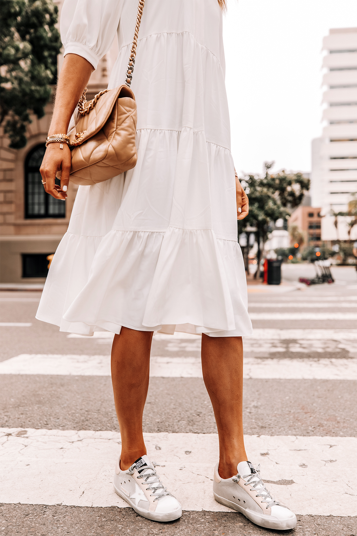 Fashion Jackson Wearing White Tiered Midi Dress Golden Goose Sneakers