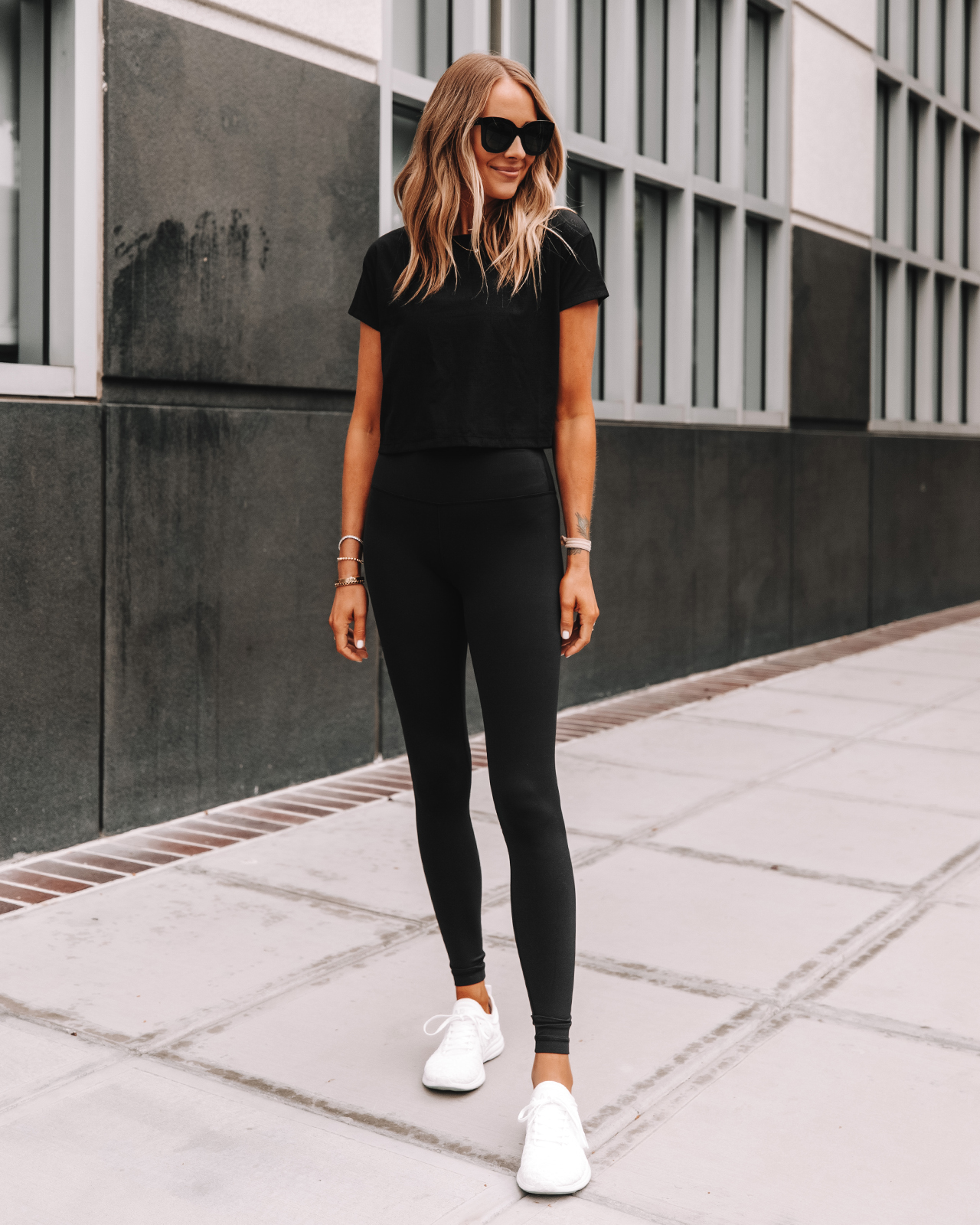 Fashion Jackson Wearing lululemon Align Black Leggings Black Workout Top APL White Sneakers