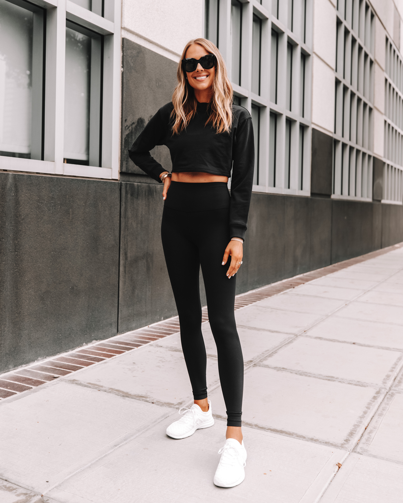 Fashion Jackson Wearing lululemon Black Cropped Sweatshirt lululemon Align Black Leggings APL White Sneakers