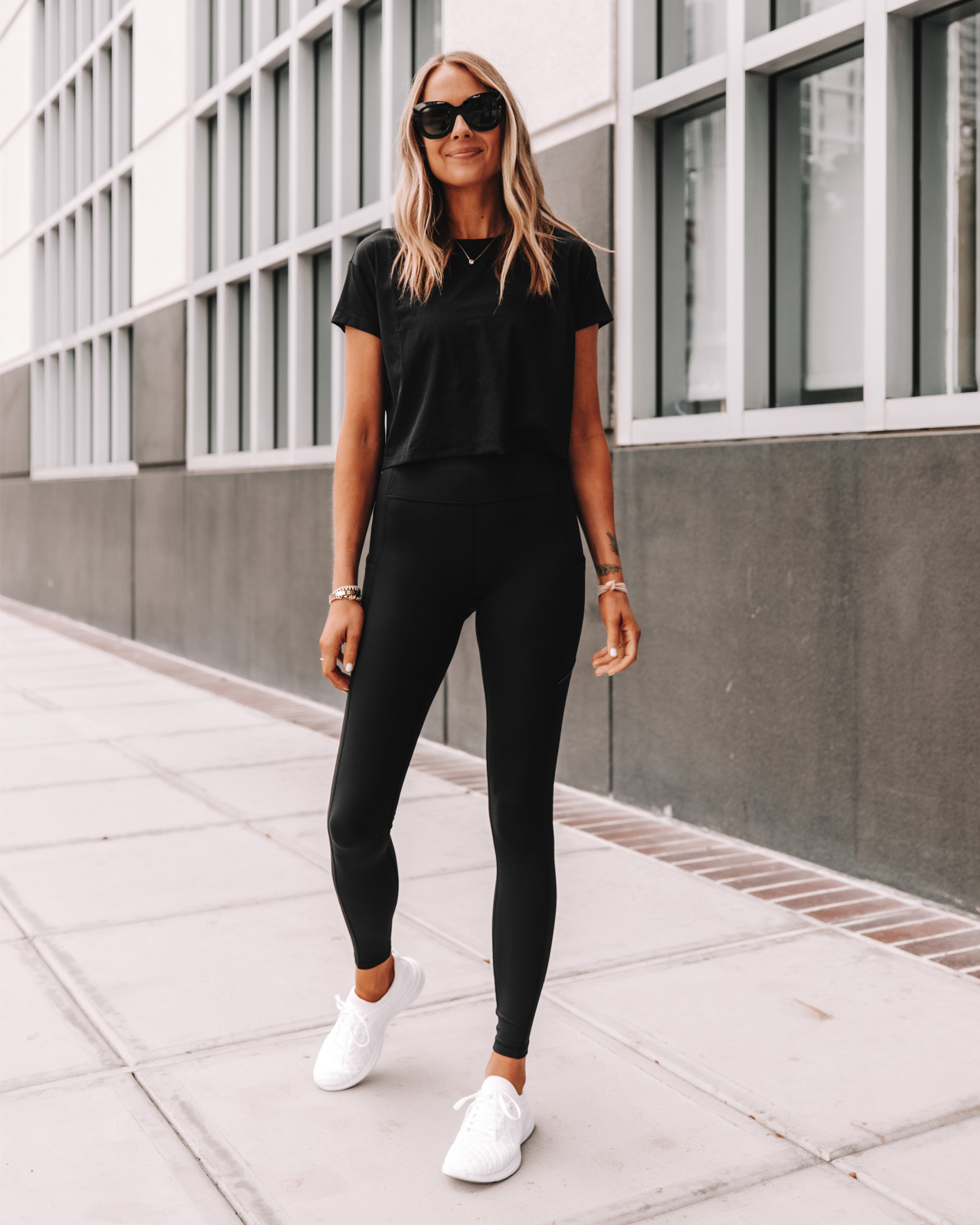 Fashion Jackson Wearing lululemon Speed Up Tights Black Leggings Black Workout Top APL White Sneakers
