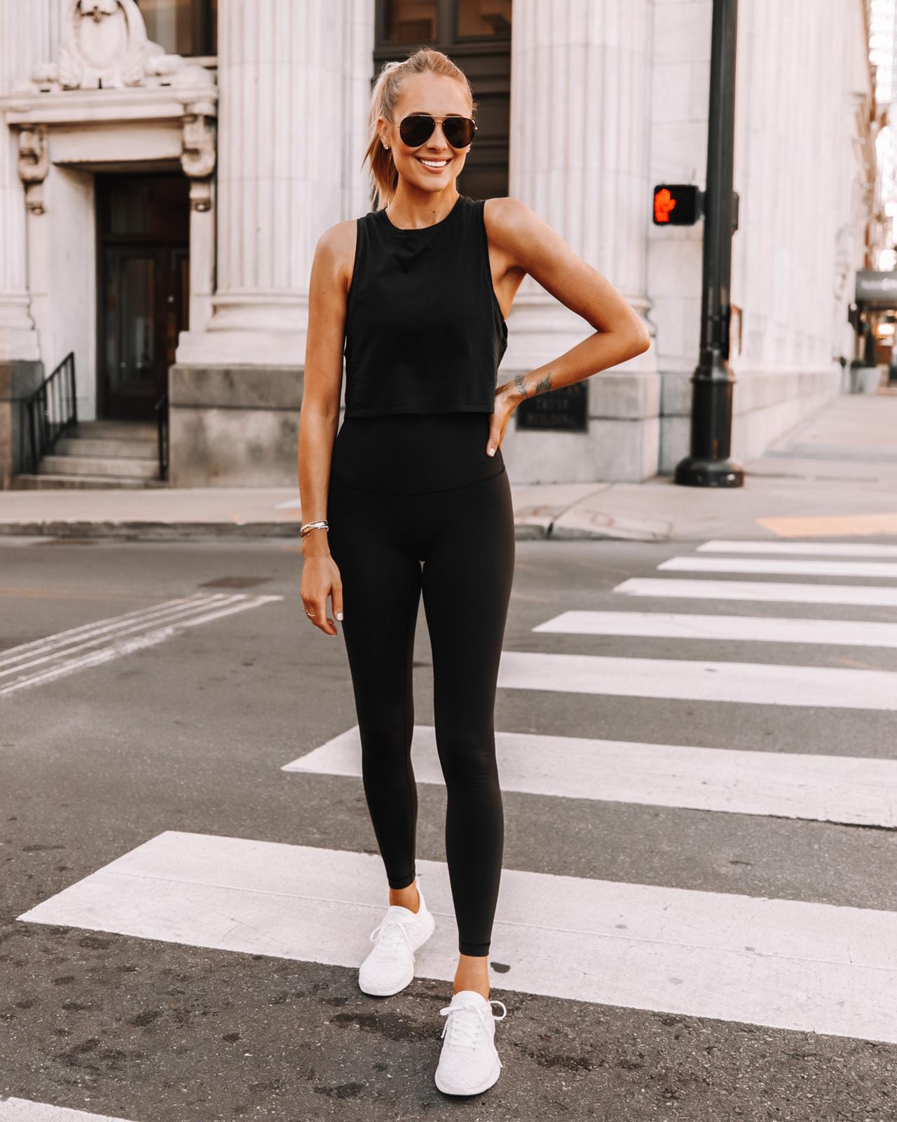 Fashion Jackson Wearing lululemon black tank wunder under leggings white APL sneakers fitness outfit