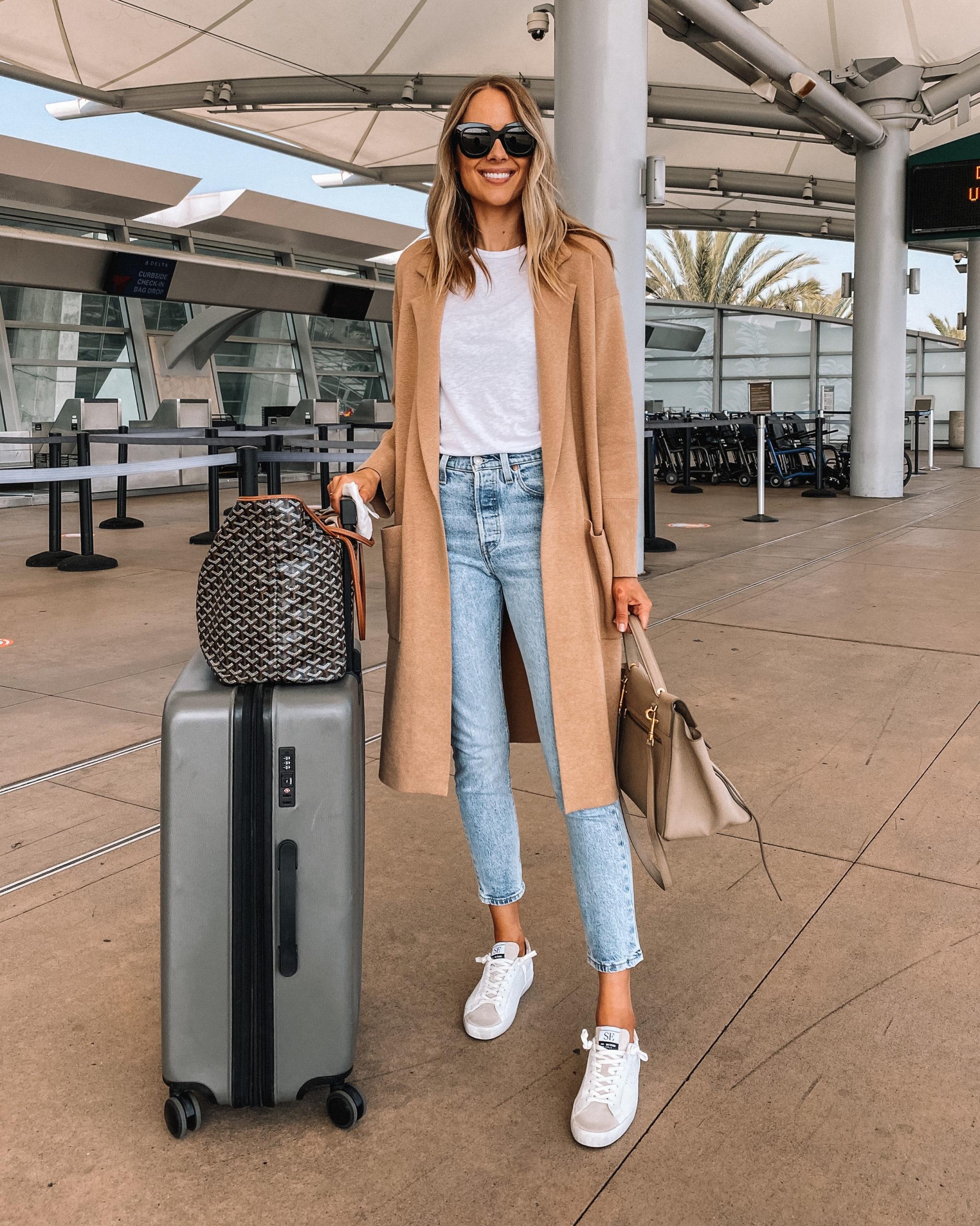 Fashion Jackson Travel Outfit Camel Coatigan White Tshirt Denim Jeans White Sneakers