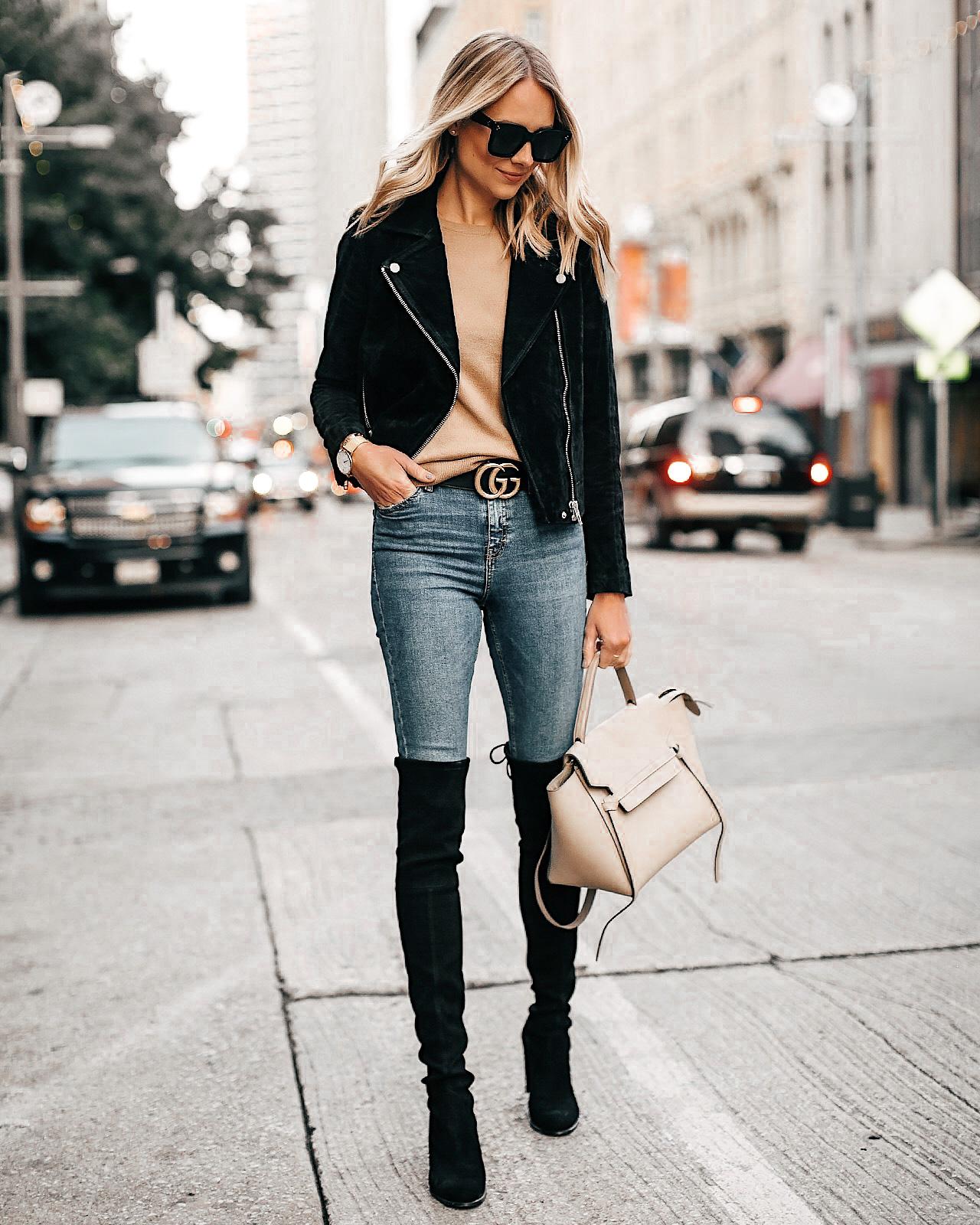 Fashion Jackson Wearing Black Suede Jacket Black Over the Knee Boots Gucci Belt Tan Sweater Denim Skinny Jeans