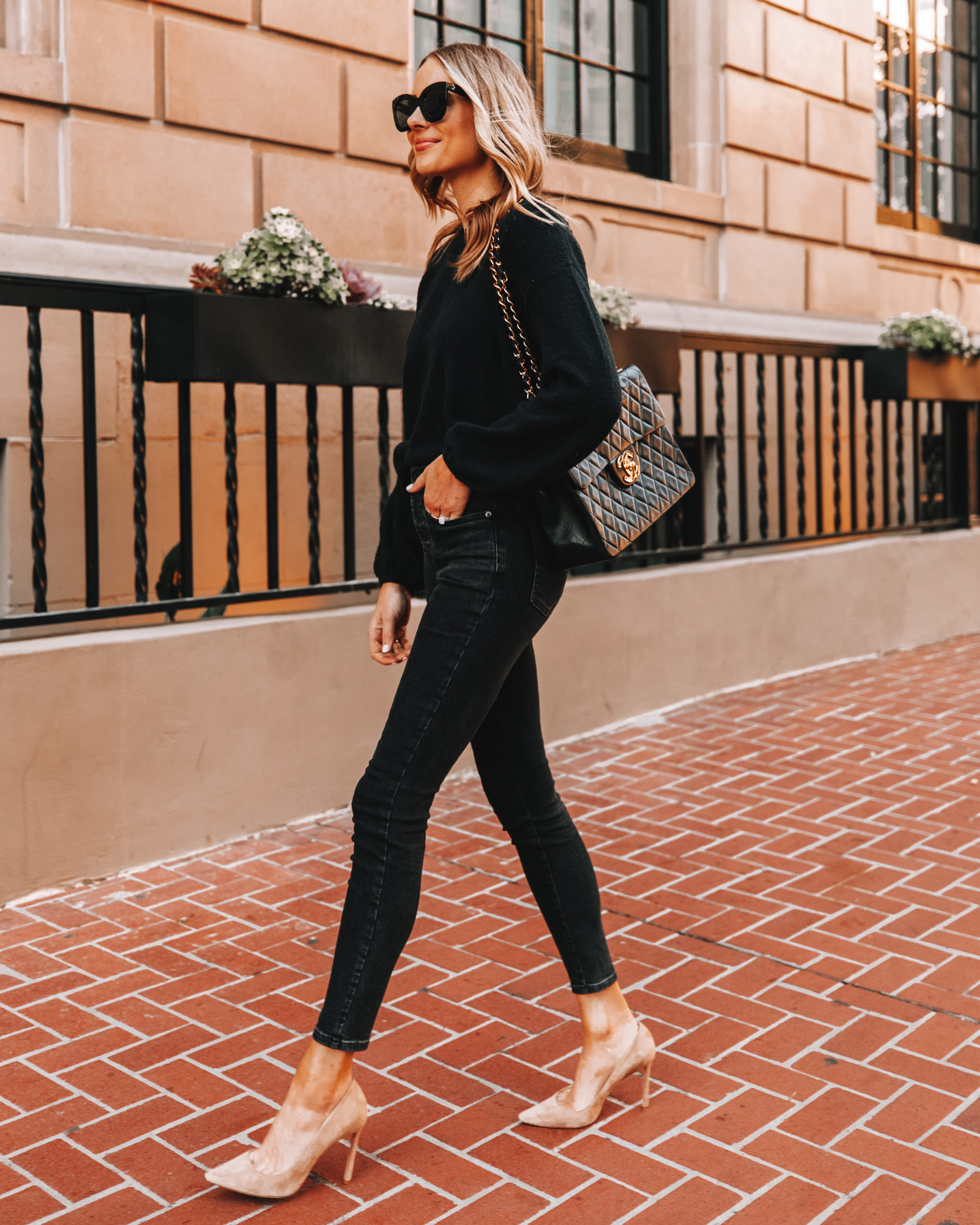 Fashion Jackson Wearing Black Sweater Black Skinny Jeans Nude Pumps Black Chanel Handbag