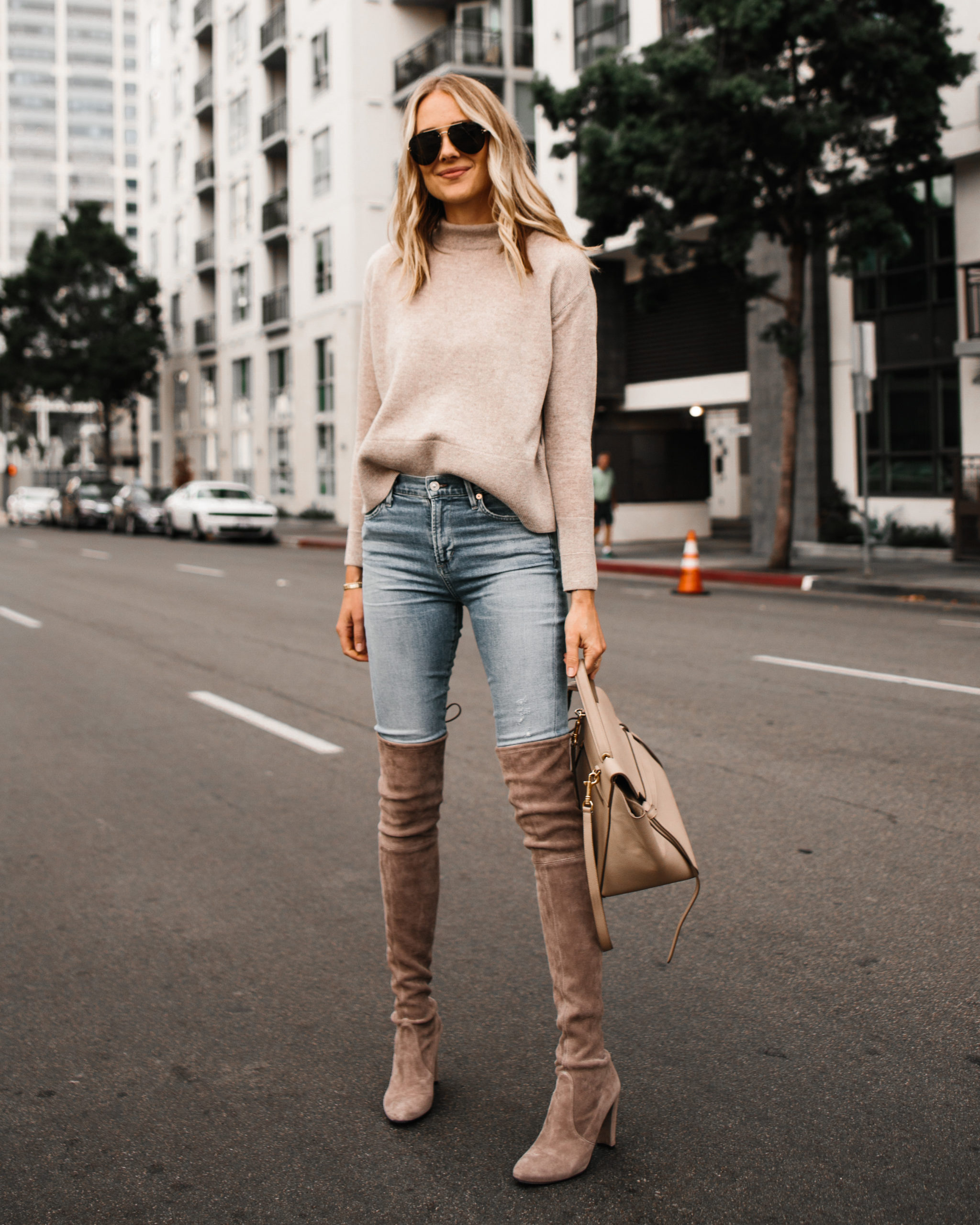 Fashion Jackson Wearing Blush Sweater Denim Skinny Jeans Taupe Over the Knee Boots
