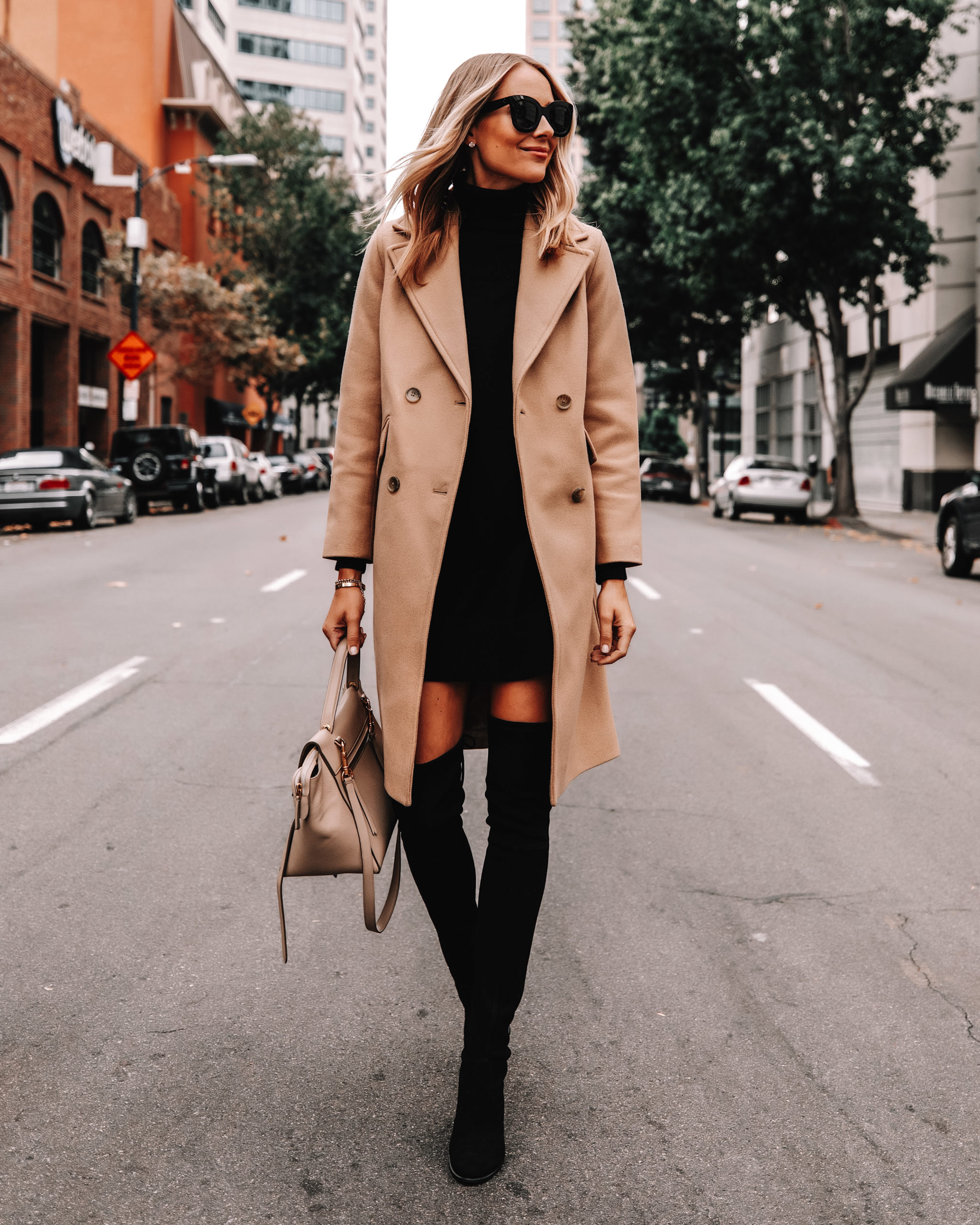 Fashion Jackson Wearing Everlane Camel Coat Black Sweater Dress Black Over the Knee Boots