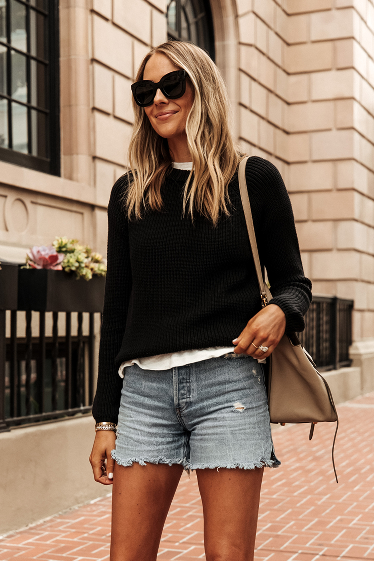 Fashion Jackson Wearing Jenni Kayne Black Fisherman Sweater White Tshirt Denim Shorts 1
